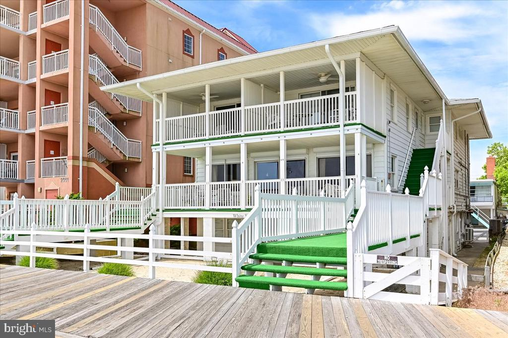 Direct oceanfront and boardwalk, this classic Ocean City condo is the perfect beach home! Features 4 bedrooms, 3 bathrooms, large open concept living room, dining room and kitchen.  Rare opportunity for such a large unit--over 2,000 square feet and the entire 2nd floor of the building!  You'll have beautiful beach front views in this bright condo and enjoy the ocean breeze on the spacious front porch.   Great investor property with potential for high volume rental income!