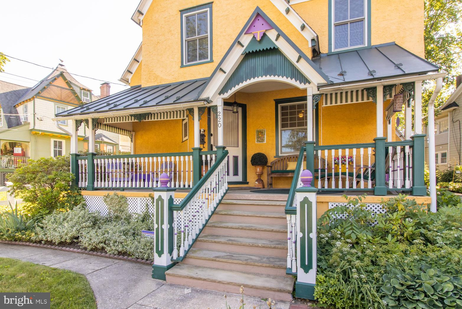 The convenience of city living in a beautiful suburban neighborhood! This spectacular Queen Anne Victorian home, in pristine condition, is a site to be seen.  A seamless blend of modern conveniences combined with historic character and architectural details.  The owner spared no expense when doing a full 2-year renovation of the entire house, all while keeping the intricate trims and vibrant colors of Victorian architecture.  The richly decorative and ornate features of the home include detailed millwork, beautiful diamond windows, wainscoting, crown moldings, and rafter tails.  This home, on fabulous Bloomingdale Avenue, has it all!  Enter the home by way of the grand sandstone staircase and step inside to appreciate the respect that was given to the history of the home.  The vestibule opens to an inviting foyer with a rebuilt, turned staircase and refinished hardwood floors, which extend throughout the home.  The living room flows into a fireside library with large windows for natural light and a gorgeous built-in bookcase.  The charming kitchen with checkerboard backsplash and built-ins has been updated with crisp white cabinetry, stainless steel appliances and quartz countertops.  Continue on to the elegant dining room featuring French doors that open to the tranquil backyard with a backdrop of the renovated, oversized garage, manicured lawns and beautiful planting beds.  A perfect place to entertain family and friends for a summer cookout.  The first floor rounds out with a renovated laundry room and full bathroom. The second floor includes a spacious master suite with a sitting area, tons of closet space and an ensuite bath.  Relax in the clawfoot tub while enjoying the abundance of natural light coming through the elegant diamond window.  The master bathroom also features double sinks and a separate room with a stall shower.  There are two more generously sized bedrooms and another full bath completing the second floor.  Head upstairs to the 4th bedroom, on i