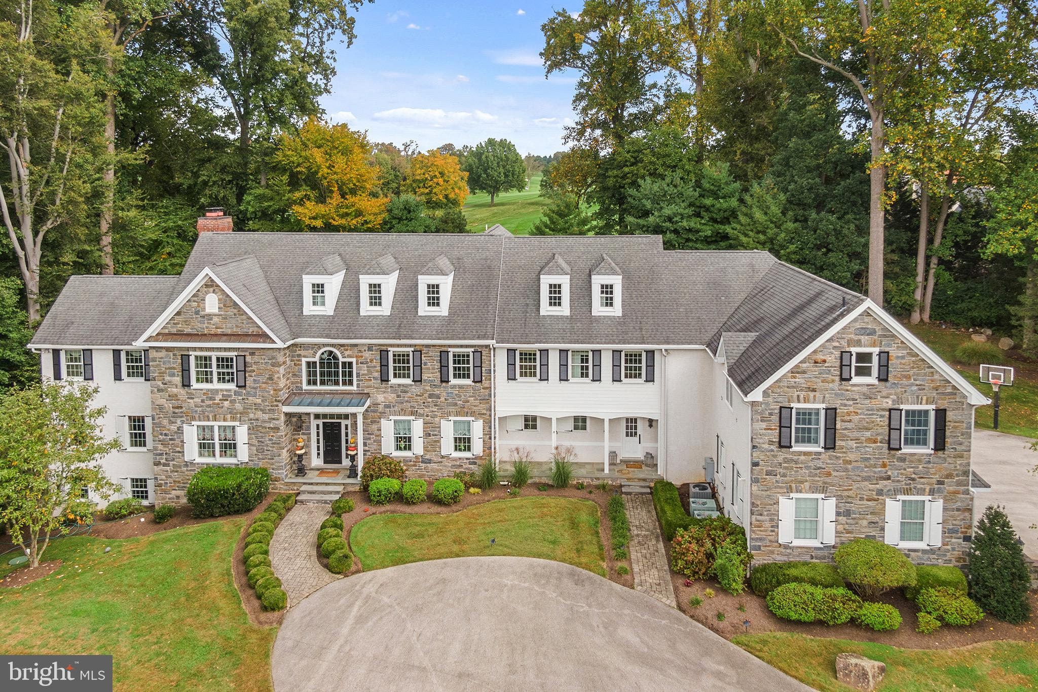 Once in a lifetime opportunity to own an exquisite 17 plus acre estate in Berwyn. This stately 12,000 sq. foot custom-built home welcomes you with a grand circular front driveway and side driveway with an attached four car garage. This estate home is perfectly situated on the 8 th hole of Waynesborough Golf Club with year-round course views. Inside, enter a two-story foyer with bridge above to main bedroom suite and rear yard views. Welcome guests in the receiving room with formal powder room beyond. Soaring 10 ft ceilings, arched doorways and timeless custom millwork, coffered ceilings and wainscoting showcase the incredible custom carpentry. This open floor plan blends everyday living and invites entertaining for the most memorable parties. The living room features a fireplace, site finished herringbone pattern hardwood floors and a window seat with golf course views. The living room connects to a private office/study including incredible woodwork and three walls of windows overlooking lush serene landscapes. The formal dining area offers deep window sills, wall sconces, wainscoting and leads to a large butler pantry with prep and storage area, wine racks, sink and more. The gourmet Kitchen features custom cabinetry, Monogram fridge, 8 burner Monogram range and professional grade double ovens, warming drawers, two sinks, island work space and pantry closet. The kitchen leads to a light filled breakfast room that empties out on to the expansive rear stone patio with firepit and gazebo. Beyond the Kitchen opens to the impressive Great room with two-story ceiling, stone fireplace, an impressive wall of windows and custom built-ins. The mudroom includes entrance to the 4-car garage, rear staircase to 2nd floor and lower level. There is a room of cubbies and plenty of closets. Step up the staircase to a separate wing with the primary bedroom suite with fireplace, vaulted ceiling and sitting area. The walk-in closet is bright and sunny and the bathroom is a retreat like