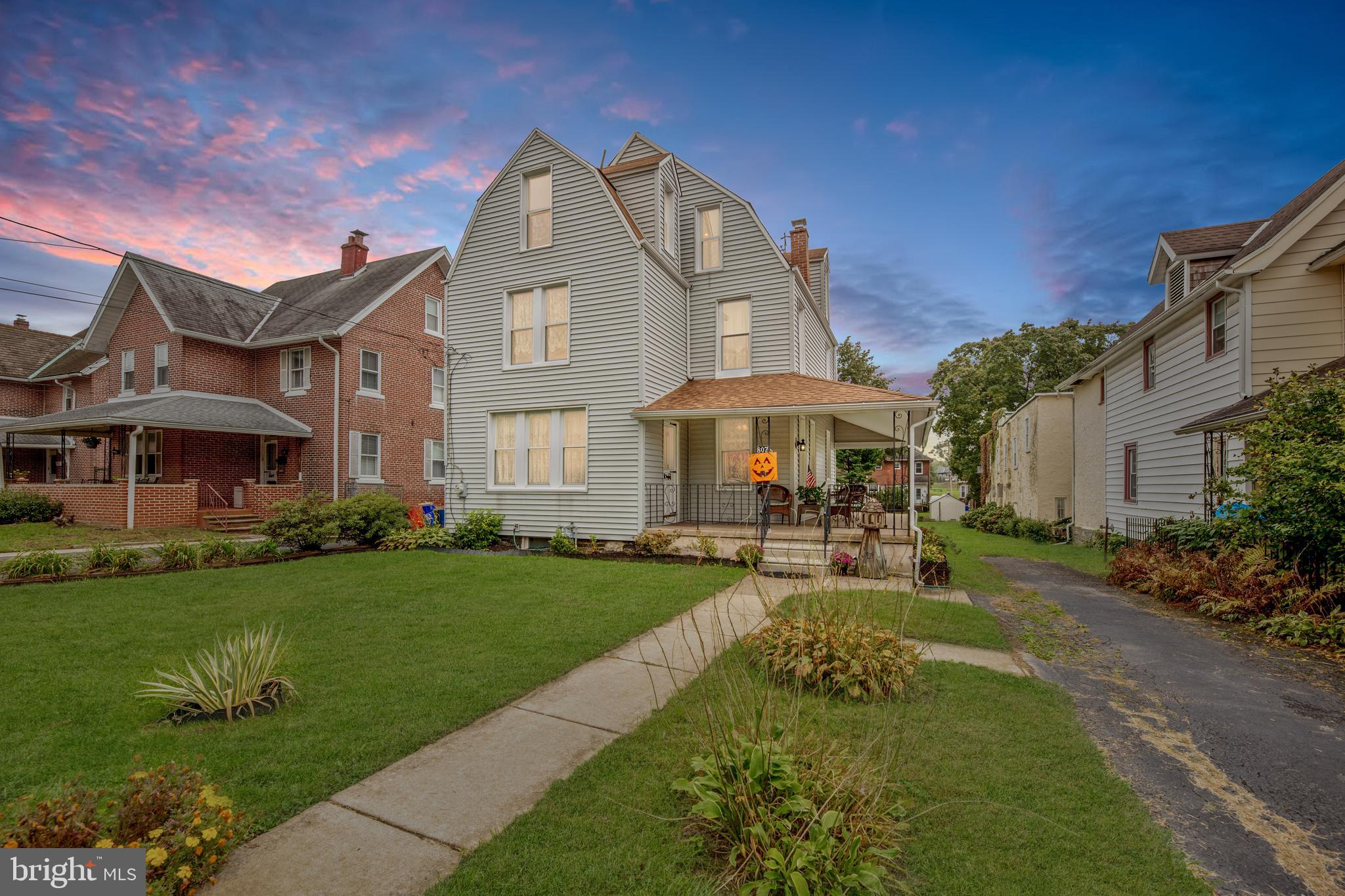 Welcome to 807 Penn Street! This historic 3-story home with wraparound porch was built in 1887 but provides all the amenities a 21st century buyer would want. Notable features include fresh paint throughout, newer central air system (2018), newer 95% efficient heater (2015), refinished hardwoods on the first floor, vinyl windows, and an abundance of natural sunlight from the plentiful windows. Enter the front door into the bright foyer with handsome hardwood floors that carry throughout most of this home. Current living room with ceiling fan and full bathroom with shower could be a great first floor primary suite complete with closet! Access the carpeted laundry room/flex room addition with exit to rear yard from here. On the other side of the foyer is a dining room with ceiling fan that flows into the updated eat-in kitchen with gorgeous all white cabinets,  great countertop space, black and stainless appliances, and a ceiling fan that completes this floorplan. Up the turned staircase find 3 carpeted bedrooms on the second floor that share 2 full hall bathrooms (one with tub and one with shower). The third floor offers 3 more bedrooms plus a huge closet. *** Please call us for the personalized website that we created especially for this home featuring a three-dimensional Matterport tour, Virtual Reality Walkthrough, detailed Floor Plan, professional photography, aerial drone footage, and community video. Disclaimer: Some photos have been digitally enhanced. *** Don't miss an opportunity to live in one of the area's most sought-after towns, with easy access to an exceptional library and a quaint downtown that includes the Bryn Mawr Farmers Market & Bryn Mawr Film Institute, the express train to Philadelphia, and the entire Main Line right at your fingertips. Proximity to prestigious schools, World-class shopping, restaurants, theatres, parks, commuter highways, and more. Top-Rated Haverford Township Schools!