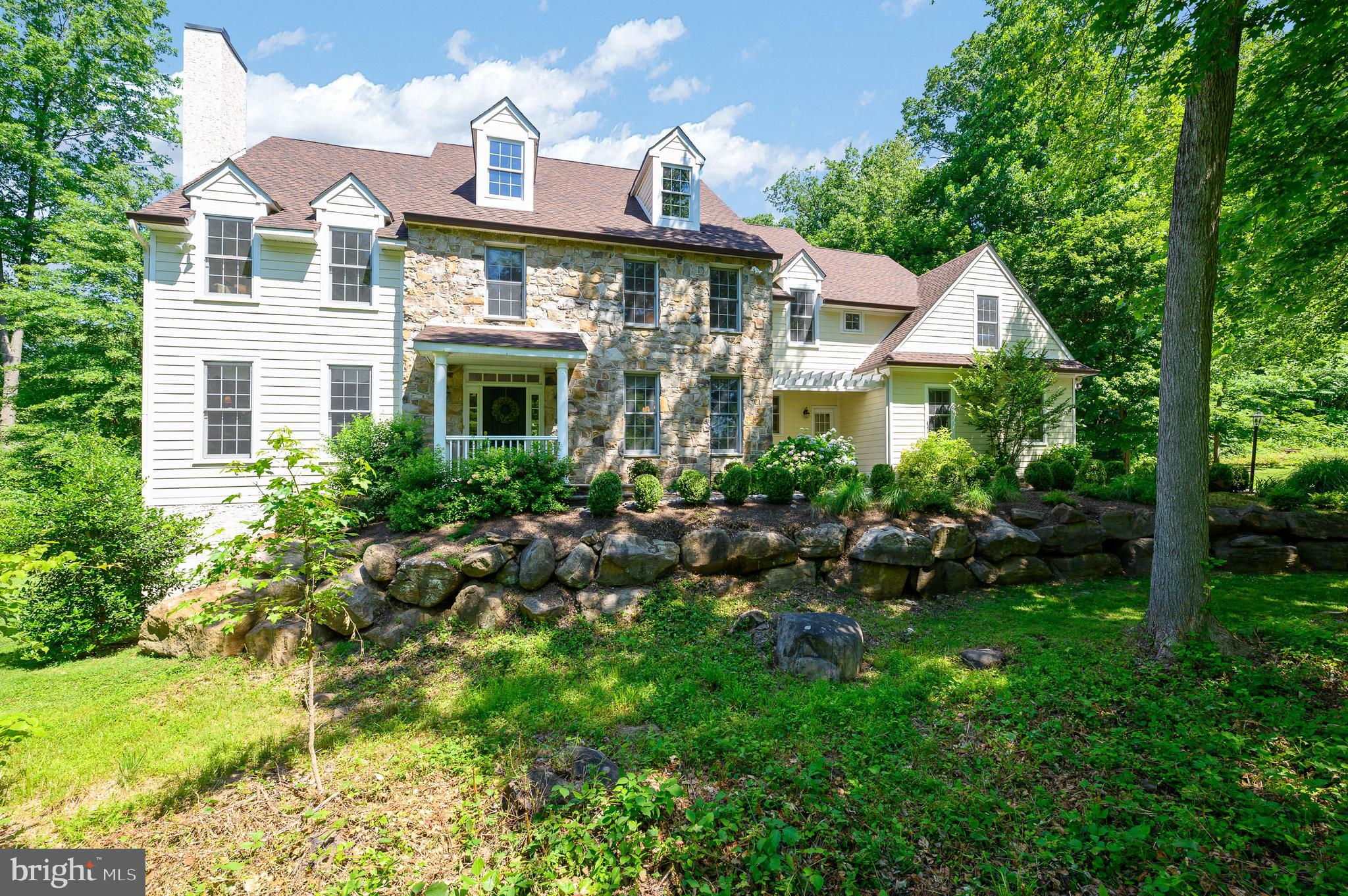 Welcome to 308 Iven Avenue-a beautifully situated property in the heart of Radnor Township and a stone's throw to downtown Wayne. Set back from the street on approx. 1.39 acres, this 5 Bedroom, 5.5 Bath Colonial style home provides ALL 5 Bedrooms on the 2nd floor. The façade is lovely with Hardi-Board and stone. Enjoy the gracious generously sized rooms, high ceilings, new carpeting, open floorplan, a back staircase, finished Lower Level, 3 Car Garage, Composite Decking overlooking the private rear yard and so much more. Inside one will discover a flexible floor plan that flows for easy living and entertaining. The first floor includes an inviting 2 story Foyer, a light filled Living Room with gas fireplace, convenient Office tucked in the rear of the home and the formal Dining Room is adjacent to the Kitchen. The heart of the home is the open layout space among the Kitchen and Family Room. A bright Kitchen with crisp white cabinetry, dark granite counters, newer stainless-steel appliances, center island and a large Breakfast Room with sliders to the deck is both spacious and comfortable. The Family Room with gas fireplace is a terrific room for watching TV, reading or playing games. Access to the 3-Car Garage, Laundry Room and Powder Room complete this level.  Upstairs boasts 5 Bedrooms and 4 Full Baths. A landing at the top of the main stairs includes built-in cabinetry and shelving. The Primary Suite is quite spacious with a Bonus Room which may be another home office, sitting or changing area, a walk-in closet and a Bathroom which provides white cabinetry and fixtures, a corner soaking tub and stall shower. Additionally, a Princess Suite offers a full en-suite Bath with a stall shower. Two additional Bedrooms share a hall full Bath with tub. The Junior Suite at the end of the hallway is dynamite space for sleeping and lounging with its full Bath and convenient access to the back staircase.  Don't miss the Lower Level with more finished living space, a Full Bathr