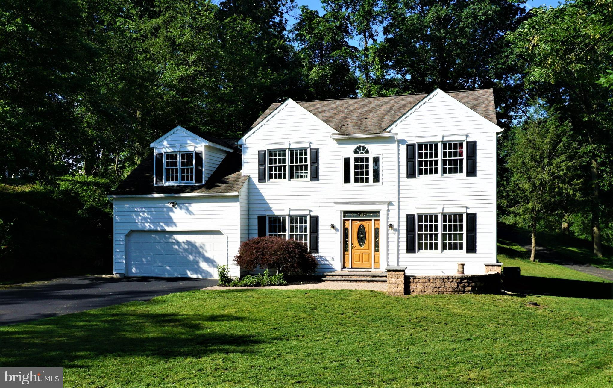 Beautifully maintained and presented center hall colonial home ready for quick occupancy. Featuring over 3,740 sf of finished space this home has it all including 4-5 bedrooms and 3 1/2 bathrooms. Tucked amongst the woodlands of the Woods of Brookfield neighborhood this prime location offers a peaceful setting sure to please. Step inside the welcoming two story foyer featuring hardwood flooring complemented with a turned hardwood staircase. The main level includes a formal living room, a private study/office with double doors and built-in bookshelves, a formal dining room, a gourmet kitchen with granite counters and a vaulted ceiling family room with a masonry gas fireplace. Finishing the main level is a half bathroom, a convenient laundry room with custom cabinetry, a two car garage and 20' rear deck featuring green woodland views. Upstairs there are four bedrooms and two baths including the spacious master suite with a vaulted ceiling, a large custom fitted walk in closet, and a luxurious master bath including a whirlpool tub, and a large stall shower with designer ceramic tile. The fully finished lower level offers the extra space you desire including a 5th bedroom/study with stairs to the side yard, a full bathroom, a second 28' family room with a kid's hideout, and a separate storage area ready for your treasures. You'll love the fresh new carpeting on the upper two levels making this home truly move in condition. The home is perfectly positioned within West Goshen Township and part of the Award Winning West Chester Schools. Come see this residence for yourself, it is surely a place you will want to call HOME.
