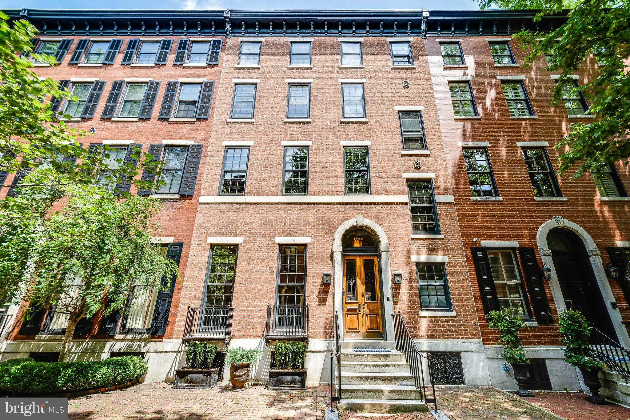 Introducing 1819 Delancey Place - Built in 1752, this is truly an Exceptional & Rare Opportunity to live in a home of this caliber, located on the most beautiful block in the Rittenhouse Square Neighborhood. The Homes façade is 29' wide with a grand entrance that will open its door to a Foyer, where you can easily greet a Host of guests. Stately wood wainscoting and hand carved stairwell sets the tone for this 6 bedroom, 6300sf meticulously restored Historic Home. Southern Exposure light floods the Living Room from the pristine hardwood floors to the 14' ceilings, outlined in Crown Molding. Not one, but 2, Marble Fireplaces, allow for a room large enough for Seating and a Piano. The Dining Room accented with Stain Glass Windows, graciously sits a table for 12. And a 2nd Foyer, with an Elevator that serves all 4 floors, and stairs to Lower Level. The Kitchen is filled with light pouring in from the Vaulted Ceilings. The true Chefs Kitchen with Wolf 6 Burner Range & Oven, Sub-Zero Refrigerator, Farmhouse Sink, and Butlers Sink. The Center Island makes for a perfect setting, to join the chef as dinner is prepared! Double sliding French Doors lead to a Balcony for Grilling & Entertaining. Off the Hall near Kitchen is the Artful Wood Carved Custom Elevator that serves all 4 floors and lower level. LOWER LEVEL consists of 2-CAR GARAGE, Recreation Room with wet bar, wine storage, and Powder Room. Additional Laundry Room and Large Storage Rooms. SECOND LEVEL is comprised of the Primary Suite which includes Family Room w/ Gas Fireplace, Large Custom Walk-in Closet w/ additional Washer/Dryer;  Primary Bedroom and Primary Bath with Custom Double Vanities and Shower Rooms tucked away behind frosted glass doors. THIRD LEVEL continues with 3 Bedrooms and 2 newly renovated Bathrooms. Each Bedroom has its own fireplace. Owner uses a Bedroom for WORK-AT-HOME OFFICE. FOURTH LEVEL features 2 additional Bedrooms and Full Baths, Separate Walk-in Closet with plenty of storage and Cedar C
