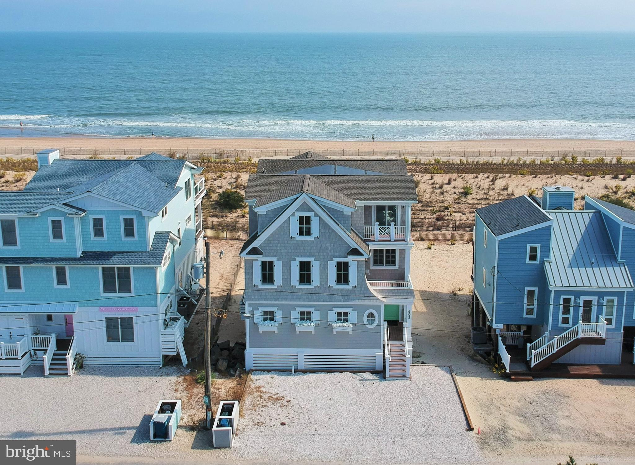 This stunning Oceanfront home was built in 2020 by recognized builder, Marnie Oursler and is appointed with only the highest end finishes through out.  Designed to capture unparalleled views of the ocean from nearly every room, absolutely no detail was spared in this luxury beach home.  Upon entering, the impressive foyer welcomes you to the first level which features an intricate en-suite bunk room, a second living room or 6th bedroom is also on this level as well as a powder room, outside shower and dream laundry room equipped with high end cabinetry and a beverage refrigerator to make coming and going to the beach a breeze.  Take the elevator or stunning staircase to the main level where the impressive light filled great room perfectly blends a dream gourmet kitchen with the dining area, living room with wet bar and over-sized screened porch plus a sun deck.  A pantry, powder room and en-suite bedroom complete this floor.  The upper level features a spacious primary suite with an over-sized deck and dramatic views of the ocean from every corner. This level is complete with two additional en-suite bedrooms.  No expense was spared from start to finish as this home offers the very finest in beach living. NuCedar PVC shingle siding, Wolfe and Cove appliances, quartz counter tops, Calacatta Berini marble surround for the fireplace and wet bar plus an abundance of light fixtures by Serena and Lily.  This home has steel plates on 6000 psi pre-stressed concrete columns and the exterior is 2 x 6 framing.  This beach house strikes the perfect balance between luxury and comfort. Located on a quiet life guarded beach close to downtown Bethany's shops and restaurants.