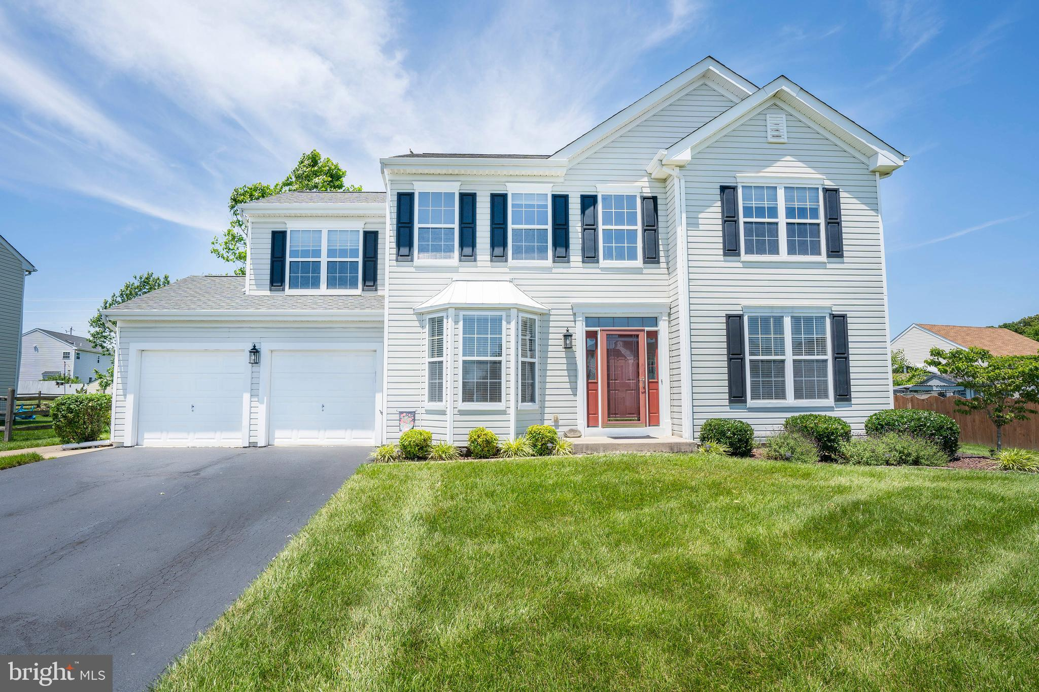 RIVEREDGE ESTATES - Beautifully maintained 4-Bedroom, 2.5-Bathroom Colonial located in a unique river-front community.  Arrive to find plenty of parking space, with a 2-CAR GARAGE and private driveway.  Enter into the 2-story foyer where you will find neutral paint & HARDWOOD FLOORS that run throughout the entire first floor.  To the right you will find the formal living room & to the left you will find the formal dining room.  The dining room boasts chair rail molding, a chandelier, and beautiful bay windows that allow plenty of sunlight to flow throughout.  Just off the dining room is the kitchen.  The kitchen features: STAINLESS STEEL APPLIANCES, tile backsplash, recessed lights and low-maintenance QUARTZ COUNTERTOPS!  Sliders from the kitchen lead to the large back patio that looks out upon the yard.  The yard backs to a tree line & a SHED IS INCLUDED for all of your outdoor storage needs!  Back inside and open to the kitchen is the family room, perfect for entertaining!  Also on the main level is a powder room, laundry room, and access to the garage.  Head upstairs to find 4 bedrooms and 2 full baths.  The master suite flaunts vaulted ceilings, a WALK-IN CLOSET, & a 5-piece master bathroom.  The master bath includes a double vanity, a stall shower, and a jacuzzi tub.  The remaining bedrooms are all of good size & another full bath can be found down the hall.  An unfinished basement (with bilco door access to the yard) offers tons of storage space and the possibility of finishing off for added living space.  Other notable features include: NEWER HVAC (2017), NEWER ROOF (2016), NEW CARPET & NEW HARDWOOD THROUGHOUT!  Located in a unique, serene community with views of the Delaware River all along Riveredge Drive and access to a PRIVATE BEACH.  Within minutes of major local roadways, DE-13, DE-1, DE-40, & DE-273.  Don't wait, call today to schedule your tour before it's too late!