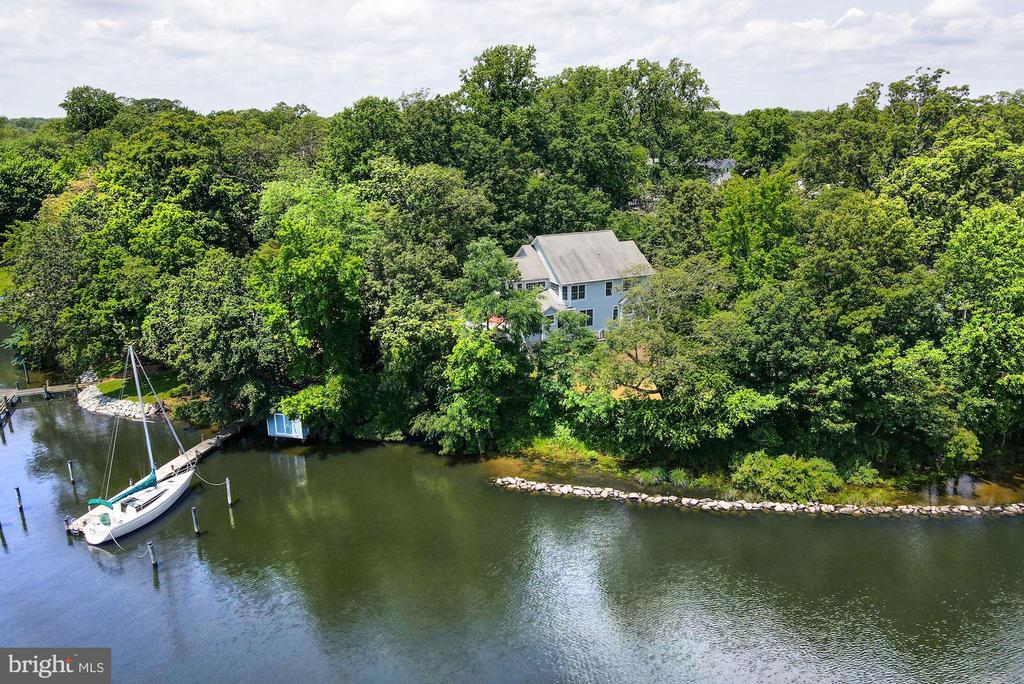 Sited on back Creek with over 200' of water frontage, this beautiful residence is highlighted by an open sunbathed floor plan and deep-water pier.   The main level features a gourmet eat-in kitchen with breakfast area, a great room with gas fireplace opening to a large rear deck, formal living room with gas fireplace, dining room, powder room, and mud room to garage.  The second level offers a large sunbathed primary bedroom with generous primary bathroom and a walk-in closet.  The second level is completed by a second bedroom with ensuite bathroom, 2 additional bedrooms, a bathroom, and laundry.  The expansive walk-out lower level offers a recreation room, media area, bonus room, full bathroom, and ample storage.  The deep pier offers 5' MLW and storage shed on the water.  Back Creek offers easy access to Severn River and the Bay.  Eastport and downtown Annapolis are 5 minutes away.