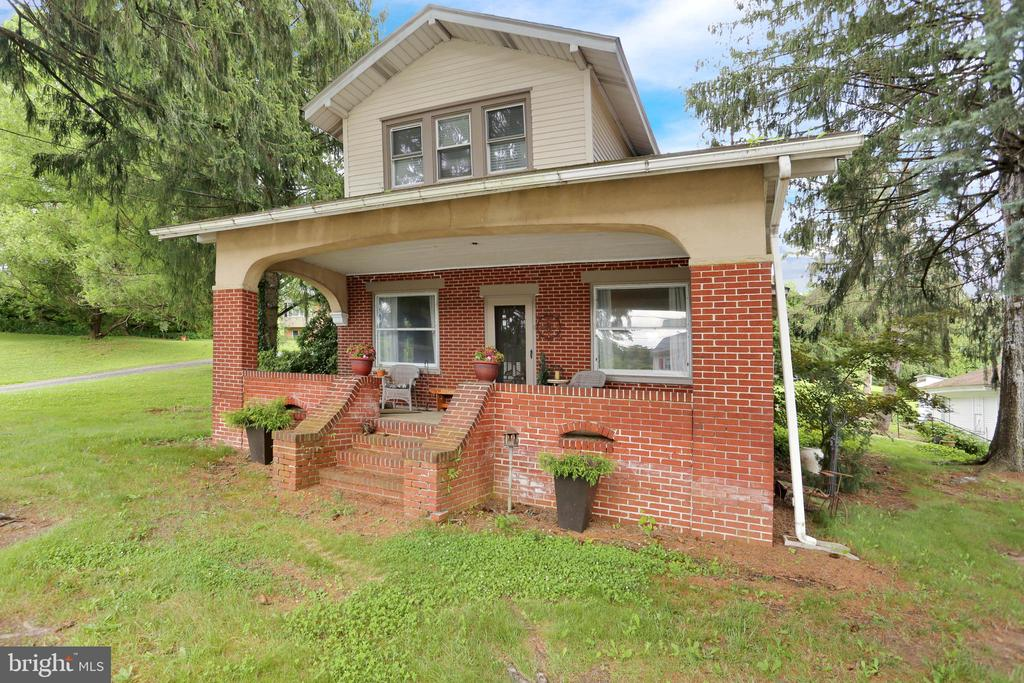 It's what you've been looking  for. Boyertown School District. Solid brick home with 4 bedrooms, 1.5 baths, beautifully updated kitchen with cherry cabinets.  Hardwood floors throughout. Formal dinning room. Living room features wood burning fireplace backed by two beautiful stain glass windows. As you walk up the steps, take note of the craftsmanship that adorns the banister and staircase. The bedrooms feature large closets. The master bed feature two large walk-ins. There is an extra room for storage upstairs with a large cedar closet and some unfinished attic space with floor for extra storage.  Enjoy your coffee in the enclosed heated porch while you watch the rain in the warmth or open the windows and enjoy a nice cool evening. This home sits on 1.28 acres and offers a three car detached garage with plenty of extra space for your camper or additional vehicles.