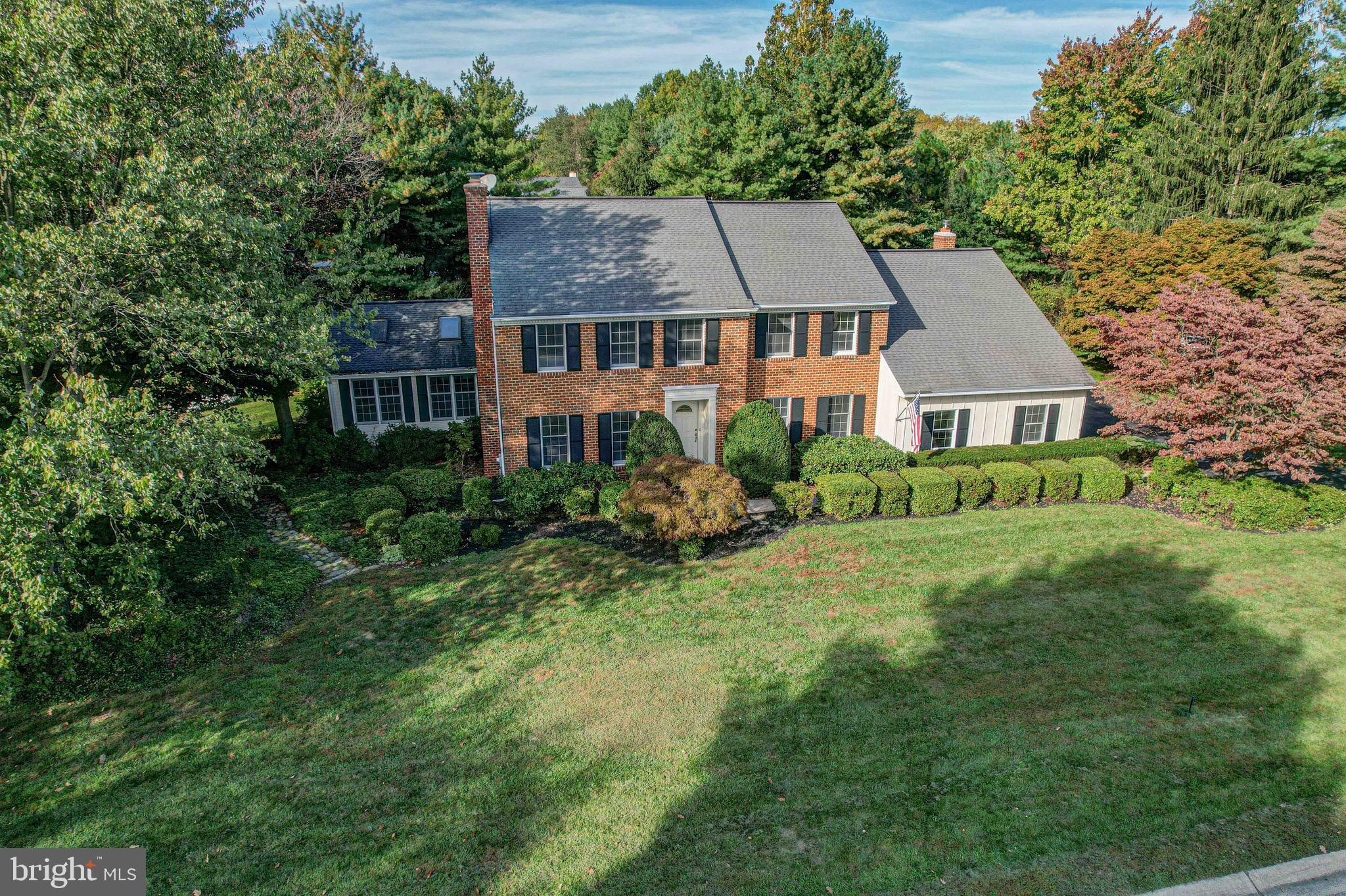 An exquisite home in an exquisite location, this stunning house is on the market now and awaiting YOU to call it home. Located in West Riding, one of Hockessin's most desirable neighborhoods, you will instantly fall in love with the quiet and spacious feel. Located on a lush one acre lot, the mature trees and landscaping offer infinite privacy and gorgeous curb appeal that's enhanced by the classic brick front and two car garage. The backyard is a dream retreat full of stunning gardens and beautiful views to be enjoyed from the large deck, and an incredible in-ground pool and diving board that is ready for you to take a dive! The pool is fully fenced and surrounded by hedging for privacy. Inside, you'll immediately be greeted by stunning hardwood floors and a stunning staircase that make for a warm and welcoming entrance. To your left, a stunning formal sitting room with detailed brick fireplace create an elegant feel. To the left, a dining room leads into an eat-in kitchen with a bay window. The functional layout allows for tons of storage and counter space. Be sure to check out the powder room, main floor bedroom, and MASSIVE sun room with stunning wood paneling detail on the ceiling with large beams and window benches that allow a cozy place to sit and admire any angle of your beautiful property. Just around the corner a massive family room with pitched ceilings, exposed beams, and a stunning brick feature wall with fireplace make for the coziest place to gather with family. A spiral staircase leads to a loft area overlooking the family room, and continues down the hall to the bedroom space. The large master bedroom has his and hers closets and a large master bath with walk-in shower, and three more spacious bedrooms share a full hall bath with double vanity. The basement is finished and offers MULTIPLE rooms for entertaining and relaxation, as well as extra unfinished storage space! This gem will not last long, be the first to see it for a chance to make it your