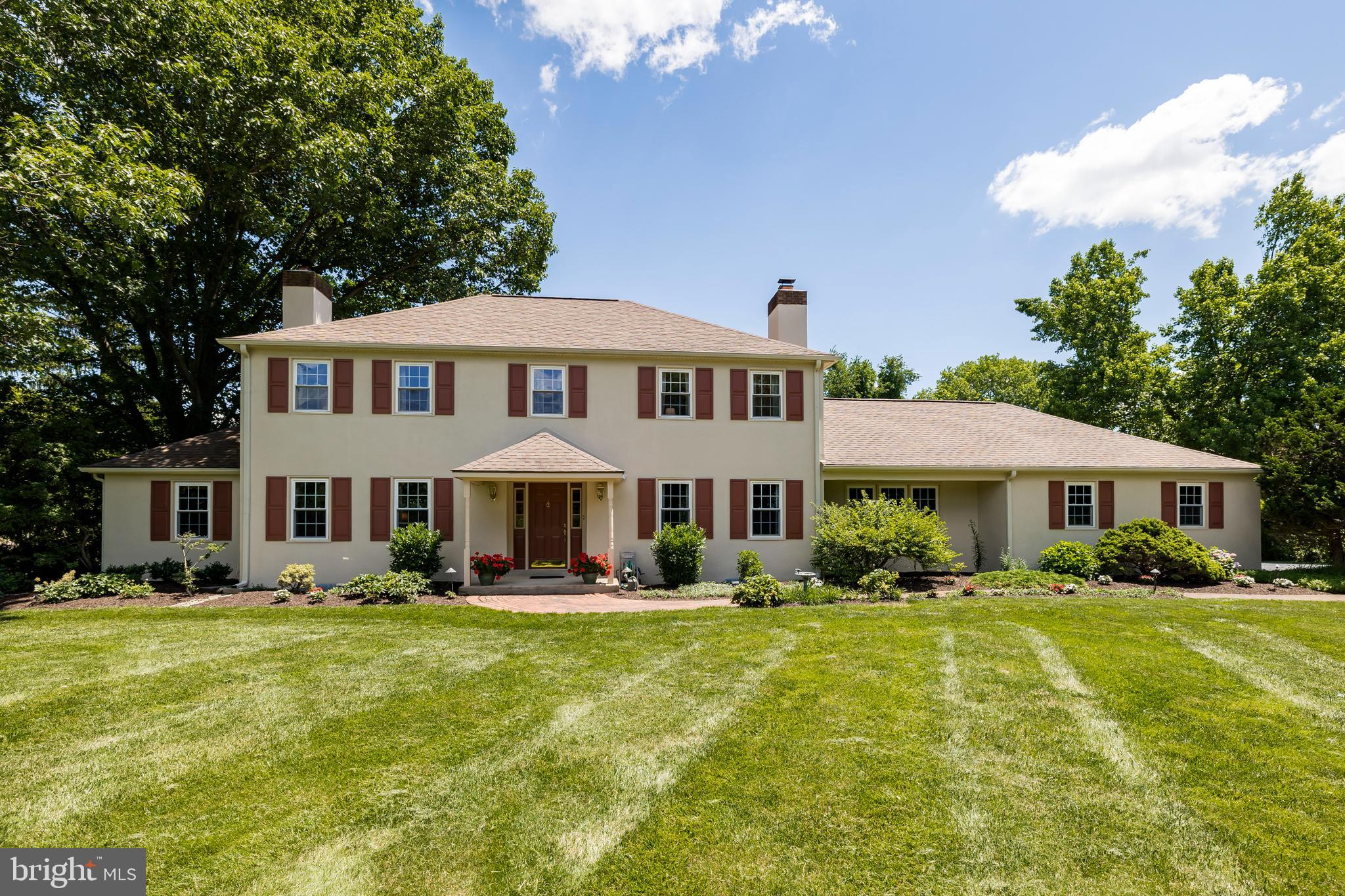 """This executive home sits on 2.7 manicured acres in the heart of Thornbury Township within the Award Wining West Chester Schools and Rustin High School district with low property taxes.  This home features a true IN-LAW SUITE or """"Cottage"""" with a complete separate entrance AND a one car attached garage.  The """"Cottage"""" has a bedroom, full bathroom, kitchen, washer and dryer along with a nice living area and is connected to the main house through the wonderful 4 season Solarium that looks out to a very private back yard and gardens.  The main house is a stately 4 bedroom, 2.5 bathroom classic colonial with a true """"Tree Lined Driveway"""" that starts your tour.  The driveway brings you to the side load 2 car garage and the one car garage for the """"Cottage"""" and the separate entrance to the """"Cottage"""" or In-Law Suite.  The main entrance to this home starts with a small covered porch, foyer w/hardwood floors and opens up to the formal living room with hardwood floors, crown molding and a formal dining room with  hardwood floors, chair rails and crown molding. The Updated Kitchen has a nice size island w/ granite counter tops, beautiful kitchen cabinets, great eating area w/ bay windows looking out the backyard, the kitchen opens up to a unique large (23'x15') family room with a raised hearth fireplace, cathedral ceilings and beams, pegged random width hardwood floors and built in bookcases. Next to the formal living room is a wonderful and private Den/Office with it's own fireplace and hardwood floors.  The second floor of this fine home is just as nice and updated as the first floor with a large (23'x13') main bedroom suite including a spacious updated full bathroom and walk in closets.  There are 3 additional very nice sized bedrooms and a full hall bathroom to finish off the second floor.  The basement has been freshly painted and is partially finished with carpet, drop ceilings, wainscoting along with a separate work/utility room. This is a wonderful opportunity to own a hom"""