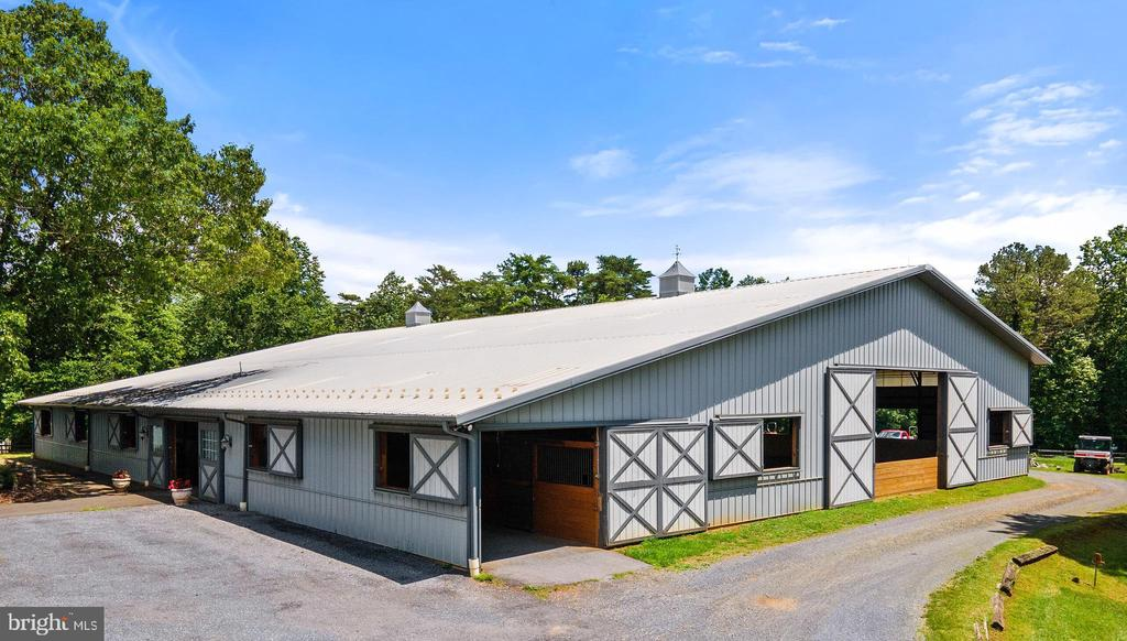 Presenting Shadow Fox Farm, a once in a lifetime offering in Hume, VA, located just 3 miles from the Old Dominion Hound Kennels, in the heart of Fauquier County's Horse Country.  Every detail of this property is designed with the avid equestrian in mind.   The 20 cleared acres are fenced and double cross fenced creating a total of 12 paddocks. The 12 paddocks are composed of; 5 paddocks with Diamond Wire Fencing and Fry Gates for foal safety, the other 7 paddocks flank the driveway of the property with three board fencing, two loafing sheds,and all of which are well shaded with mature trees.  Shadow Fox Farm is a turnkey operation for breeding, training, or hobby. Both of the barns have been strategically laid out for luxury to the horseman and to safely accommodate operations for broodmares, foals, and stallions. A 72'x135' indoor arena with sand footing, the second level viewing room, tack room, and  6 stalls complete this arena set up and make it ideal for any rider.  Centrally located to the arena is a stunning 6 stall center aisle barn with a broodmare stall, wash rack, and large feed room.   The large custom colonial home with a view of the Blue Ridge Mountains, and pastoral views from all windows completes this amazing offering. The home features an updated gourmet kitchen with cherry cabinets and granite countertops, opening to a large family room. A beautiful and fully renovated master bath with a large walk-in shower with slipper tub. Completely finished basement with full bathroom, movie room, hobby room, and game room featuring a wood burning fireplace. All conveniently transition via the walk up basement steps to the pool and patio. Large bonus room over the garage also gives a great flex space and unlimited potential with secondary staircase access to the main level. Framing the home is lush landscaping, a flagstone walkway leading from the paved circular driveway to the inviting front porch. The inviting heated in-ground pool with a huge patio is idea