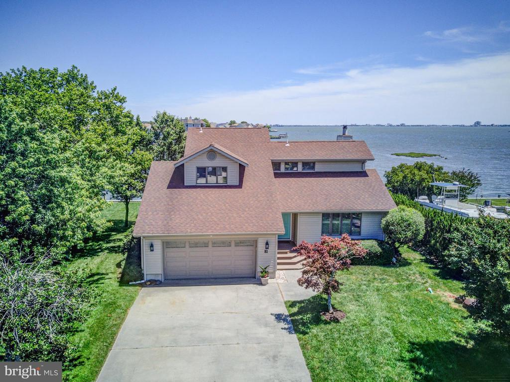 Direct bay front with Ocean City skyline views! MAJOR RENOVATIONS IN 2018-2019 including new LTV & tile flooring on first floor, tile and carpeting on second floor, heat pump with natural gas furnace back-up, new kitchen and baths, kitchen with black stainless steel appliances plus quartz counters and island with very pronounced veining in the quartz.   Yes, this is 3 bedrooms BUT HAS an additional loft that can be easily made into 4th bedroom.  UPGRADES AND LOCATION make up for a bedroom! Approx. 70' new vinyl bulkheading (new in winter of 2021!), DEEP WATER for larger boats (approx. 4' at low tide and 6' at high tide)...  ORIGINAL FAMILY MEMBER still owns this custom-built home since 1984. NEVER RENTED.   FIRST FLOOR MASTER BEDROOM with new bathroom and tiled shower, powder room plus second floor hall bath new.  House has ANDERSEN windows and glass-sliding doors, a Lennox ductless heat pump on the sunroom, roof replaced with a 30-year architectural shingles in 2004.  A detailed list of amenities and improvements at the property.   Ample storage space including eave storage areas, pull-down attic stairs to floored attic, and two-car attached garage. (garage approximately 22 X 22) Great room features vaulted ceiling with skylites...  Stone-faced accent wall in great room with gas fireplace, and approximately 548 sq. ft. of sundecks with built-in bench plus a private sundeck upstairs off of bedroom #3 with approximately 170 sq. ft. of additional deck.   If you're looking for an OUTSTANDING piece of real estate in a  GREAT waterfront location, with phenomenal views, bay breezes, Ocean City skyline views, deep water, and an exclusive neighborhood, then here you go!