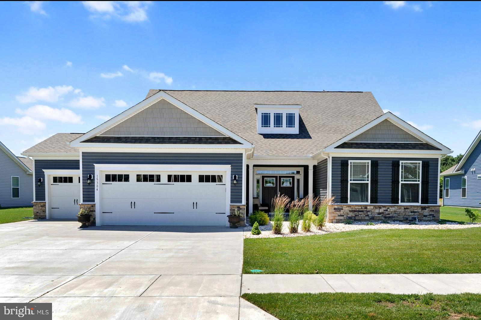 This coastal oasis is awaiting your arrival...  As you cross the threshold, you will notice the attention to detail with elegant finishes, upgraded trimwork, and an abundance of wainscoting.  The first floor features a gourmet kitchen including gleaming quartz counter tops, stainless appliance package and an abundance of workspace,  a great room that is filled with natural light with amazing pond views,  and a primary suite with luxury bath including oversized tiled shower and spacious walk-in closet,  The entry level also includes two additional bedrooms with a shared full bath and  additional 1/2 bath.  On the upper level you will find two generous bedrooms and another shared bath in neutral decor and lightly used.  Some of the additional upgrades include a 3 car garage, fenced rear yard, irrigation with dedicated well, custom lighting fixtures, and expanded patio with covered porch.  This home is better than new and will not last long.  Schedule your tour today!