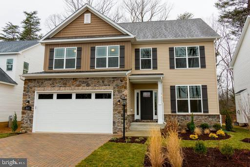 """To-Be-Built Home. Anne Arundel's County premier builder, Ameri-Star Homes, presents The Dorchester Model, a Craftsman Style 4 bedroom, 3 and a half bathroom home with 2 Car Garage located on a spectacular 7,000 square foot lot in the sought after Severna Park area. Permit is Ready for this to-be-built home. The Home features 3,320 +/- finished square feet of living space. This Dorchester Model features Elevation """"C"""" with exterior accenting stone, a portico porch, 30 Year Architectural Grade shingles, upgraded Mainstreet Siding, a fully sodded front, side and back yard (to LOD) with a generous landscaping package. Certainly, a home that you will be very proud to drive up to. The interior of the home boasts a gorgeous two-story family room with propane fireplace with a 2-story stacked-stone surround, formal living room and dining room, a private den/office and a spectacular over-sized kitchen, a large mud room and upper-level laundry. The lower level provides a large, finished basement rec room and full bath. The expansive Owner's Suite Includes a luxury bath with ceramic tiled shower walls and a separate soaking tub, along with double vanities and a private water closet. This Dorchester model offers plenty of room for expansion, including an optional 3rd floor private loft and bathroom and 2 additional optional bedrooms in the basement. This home comes with all the amenities that you deserve, including Sparkling Granite counters in the kitchen and primary bath, hardwood floors on entire main level and upper-level halls, oak switchback stairs with painted risers, stainless steel appliances, upgraded 42- inch maple kitchen cabinets including a choice for white, deep bowl stainless steel sink, ceramic bathroom and laundry room floors, cased windows and openings.  A community of sought-after schools, sports and outdoor activities, walking trails, parks and boating!!! Call us today and let us help you personalize your dream home from our professional design center. The pi"""