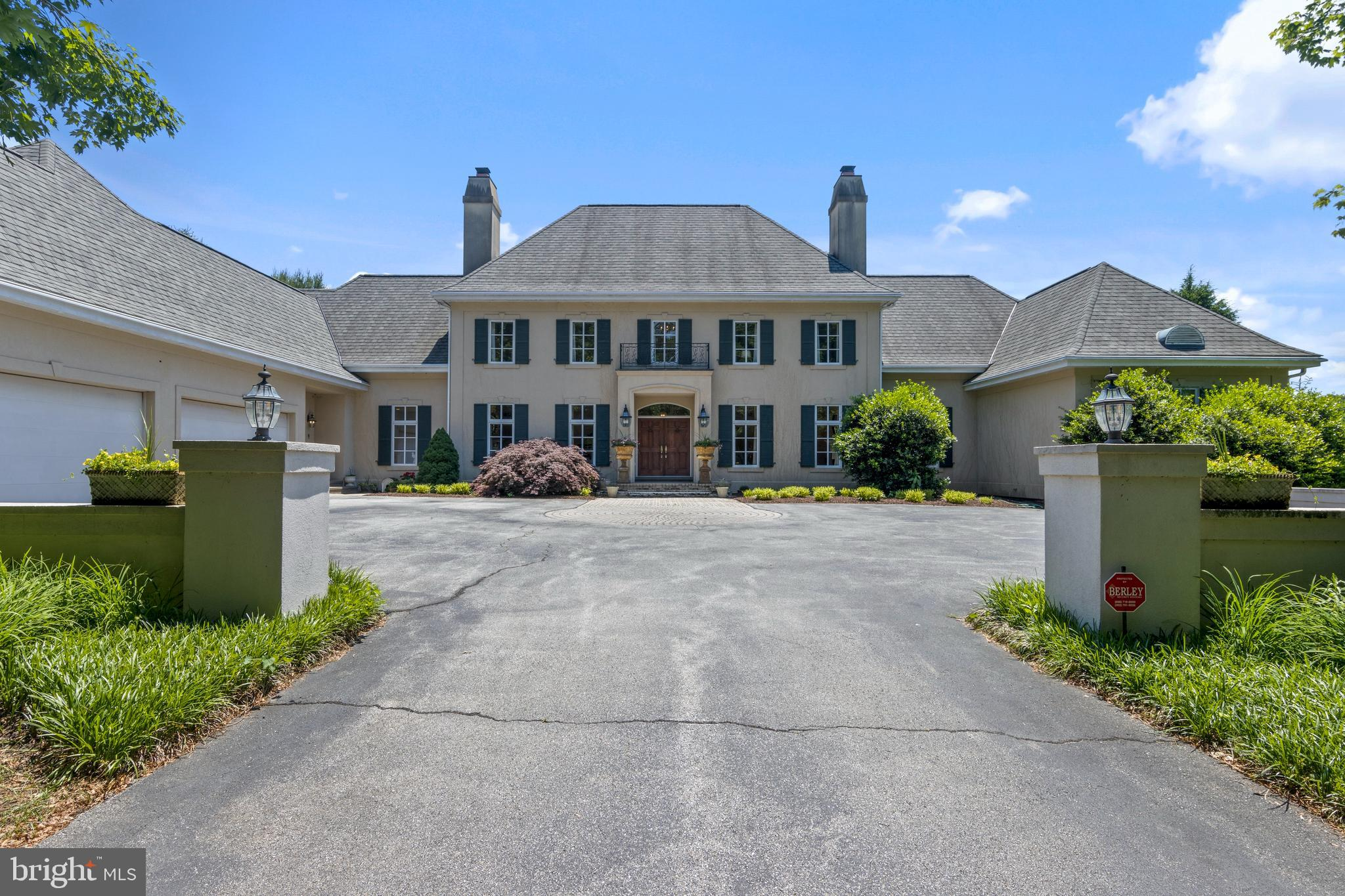 Located in the heart of Chateau Country, a French Provincial masterpiece is offered. Situated on 1.97 verdant acres, Joe Marra, one of Delaware's premier builders designed his personal dream home. The grand property was subsequently upgraded by a new owner. After entering a secluded gated driveway, observe an immense structure boasting a total of 8700 Sqft of living area. Walk through large European inspired doors to enter the expansive foyer, one notices beaming Brazilian Cherry Hardwoods throughout, Trey ceilings and wainscotting. A marble mantle enclosed fireplace provides ambiance when hosting guests in the adjacent formal dining room. Cathedral ceilings await one after a long day easily forgotten when relaxing inside the great room. Abundant natural light surrounds all living areas. A first-floor primary bedroom benefits those seeking main floor living. Connected to the first-floor primary bedroom is a large walk-in closet and professional office. Feeling inspired to prepare chef inspired home meals or hosting? You will easily find the French County kitchen's commercial grade appliances suitable. Venturing off the kitchen a Florida Room creates the perfect area to enjoy prepared hors d'oeuvres. Ascending sweeping staircases, tropical hardwoods cover the entire upper level. On the second floor you find, a full en-suite Princess suite, completed by walk in closet and tiled bathroom. Each bedroom benefits from attached en suite bathrooms. Above the garage is a hobby/playroom. Descending down to the lower level you'll find a complete wet bar, upgraded Movie Room & large windows offering fresh air and light inside a gym area. Only minutes to Downtown Wilmington made famous by Delaware's own Joe Biden. Quick access to major routes of transportation leading to Philly,NYC, DC or beyond.