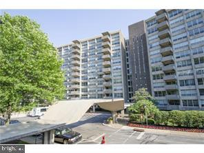 Bright & sunny, this two-bedroom condo has been converted to a one bedroom with den on the 9th floor of the East building at the Green Hill in Wynnewood.  This 2-bath unit has been lovingly cared for and the kitchen has been updated and features hardwood floors. Storage locker downstairs is included.  Breathtaking views of the tree tops from the charming balcony.  This wonderful community sits on 23 beautifully landscaped acres with indoor and outdoor pools, tennis courts, playground and walking paths. Amenities galore including 24/7 doorman, security, fitness center, free Green Hill bus service with private buses for easy access to shopping centers, grocery stores, and restaurants. The Social Club sponsors trips to the Kimmel Center, theaters and other regional cultural events. The Condo fee includes air conditioning, all ground fees, resident parking, bus service, basic cable TV, common area maintenance, electricity, trash, water, and sewer and a storage locker. Separate fees for pools, health club, social club and garage parking. Covid-19 restriction situation is currently affecting the use of some Community amenities. Enjoy easy living in this wonderful Community! The price reflects an as-is sale.