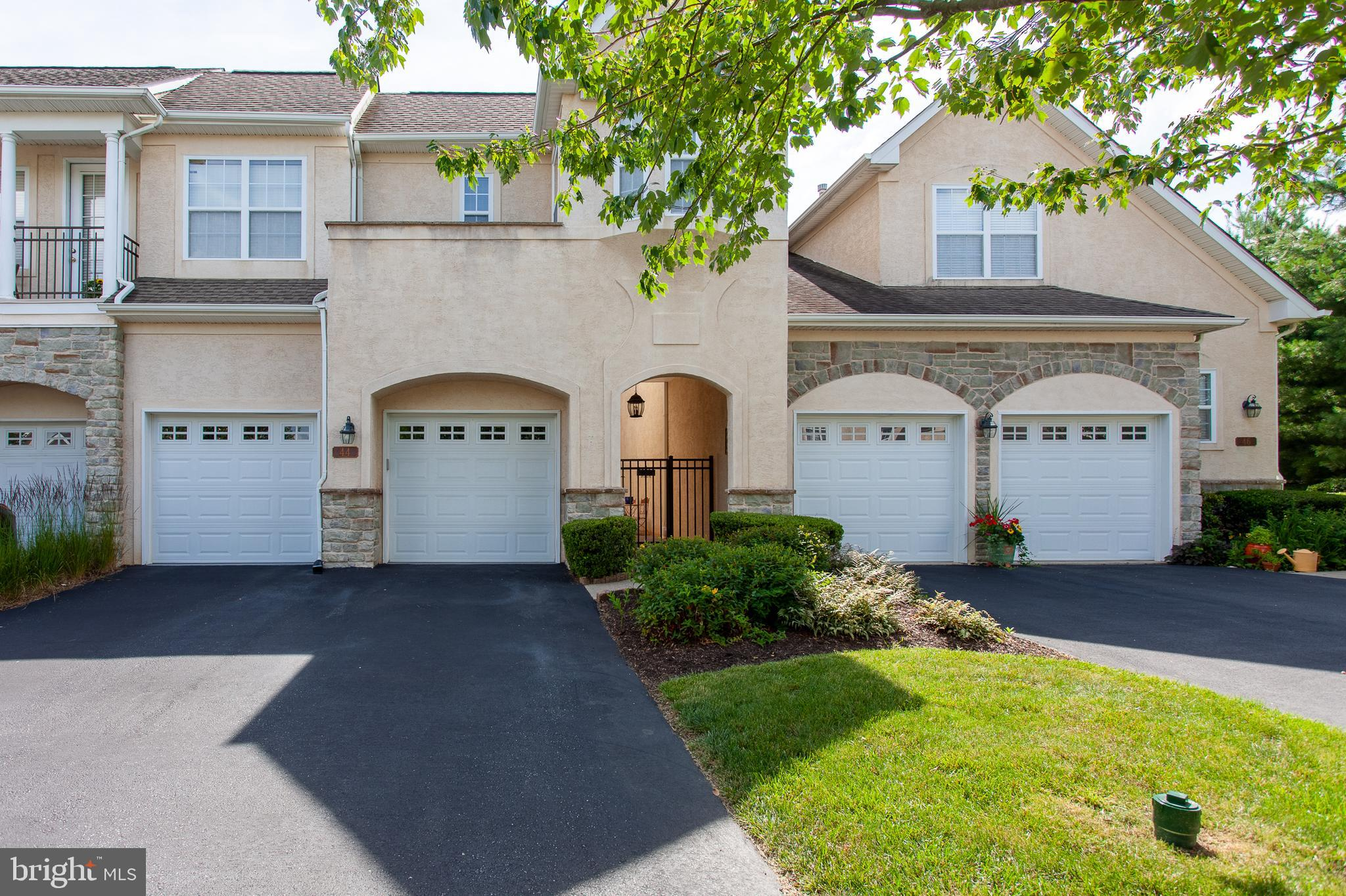 Welcome home to this beautiful Amherst model townhome in the coveted Cherry Creek Conservation Community.  This community offers a wonderful maintenance-free lifestyle, complete with low taxes and a reasonable HOA. Enter this home through the gated front courtyard with beautiful pavers and room to enjoy a quiet outdoor space.  The first floor,  with its dramatic 10-foot ceilings and gleaming hardwood floors, boasts an inviting, spacious layout with a large dining room, formal living room, and family room that share a double-sided gas fireplace, plus a beautiful gourmet eat-in kitchen with granite and Corian tops and slider access to the front courtyard.  There is also a large half bath on the first floor.  Upstairs you will find a very unique owner's suite, accessed through elegant double doors and including a beautiful bedroom with tray ceiling, two large walk-in closets with built-in organizers, a separate office space, and a luxurious owner's bath.  Two additional spacious bedrooms, a second full bath, and a conveniently located laundry room complete the second floor.  The finished lower level includes a large entertaining space with a wet bar, a third full bath, a flexible bonus room suitable for many uses, plus that all-important storage space.   This home also offers a new HVAC system (installed 2020), a two-car garage, and a deck that backs to open space.   An invasive stucco test was completed and minor repairs made in mid- 2017.  The Home Owners Association covers roof/gutter/downspout maintenance.  Cherry Creek features 80 acres of protected open space and walking trails, as well as very easy access to all the area hotspots including West Chester, Kennett Square, Wilmington, and the airport via Routes 1, 202, and 322.  All this plus the highly regarded West Chester Area School District make 44 Barn Drive a must-see!