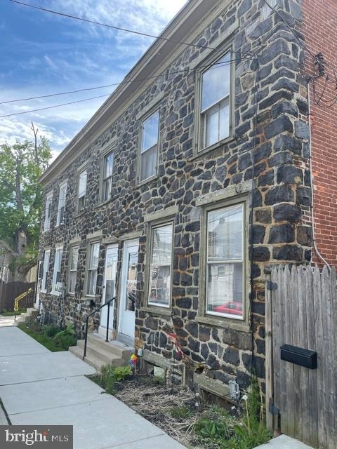 3 attached row homes with stone façade. All titled and separately deeded parcels  the 3 units are being sold as is.  All are ready for updating and renovations, currently tenant occupied on a month to month basis. 406 and 410 are rented at 1,200 per month. 408 at 1,050 per month. Excellent opportunity to purchase renovate and resell at today's current market value. Each offer oil fired hot water heat, with oil tank in basement, electric hot water, public water & sewer, natural gas is available. Large backyard.