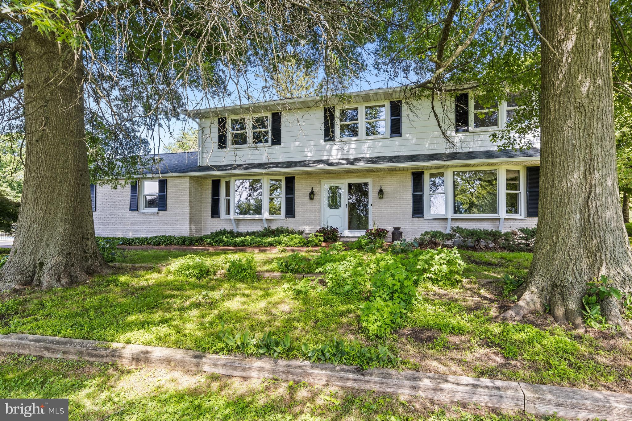 **Open House** Sunday, July 11, 11:00am-1:00pm      High on a hill in Hockessin, on the edge of nature, yet so conveniently close to Hockessin, Pike Creek, Wilmington and Newark, exists a uniquely different property. Two dwellings are set on this 3.68 acre property.  The 3,540 sqft main family residence is an over-sized 4 bedroom, 3 full bath Colonial home. The second dwelling is a 2 or 3 bedroom, 1 full bath guest house with 1,279 sqft, currently being used as a home office.  There are 4 garages and ample parking. The most outstanding feature is the outdoor space. Whether enjoying time with family or hosting lavish events, it is the ideal location for any occasion. The backyard was envisioned as an entertainment mecca for friends, family or quiet evenings enjoyed from the three-season room or the patio next to the enchanting koi pond. Experience tranquil nights and superior sunsets from the private pool deck and cabana surrounded by fragrant Zephyr rose bushes. The in-ground swimming pool has been re-plastered with new coping, filter, and pump and was converted to salt water in 2018. In addition to mature foliage such as black oak trees, magnolia bushes, pink dogwoods, cherry trees and Japanese maples, the current owners used a portion of the 3.68 acres as a blackberry farm which yielded an annual crop of pick your own blackberries. Recent home improvements include new air conditioner with 10 year transferrable warranty, main house basement renovation with new carpet, ceiling panels and fresh paint, new sump pump, new hot water heater in guest house, newly remodeled owner's suite bathroom, kitchen, breakfast area, laundry room and lower level bathroom in main house, and 2018 roof on main house.    ** Sellers are asking that ALL offers be in by 6:00pm on Wednesday, July 14, 2021 for review. **