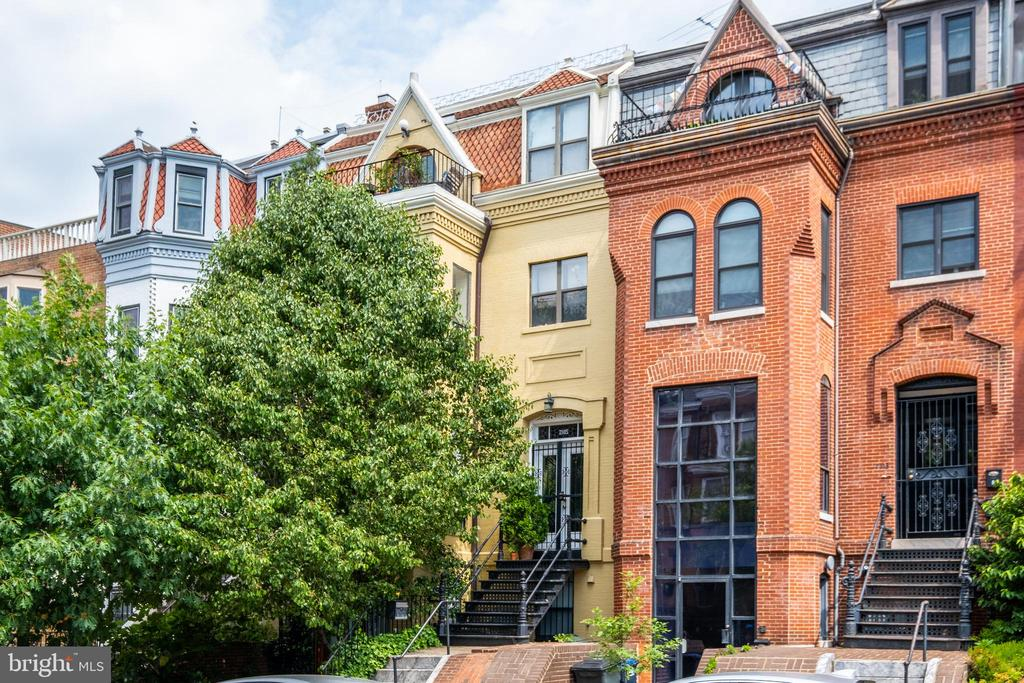 Price Reduction!   Welcome to this coveted corner of the Dupont Circle Neighborhood! Located just two blocks southwest of Dupont Circle, 2105 O St NW is a four-story townhome, with 4 beds, and 4 baths. It is currently divided into 2 units or could be combined into a dream single family home! Radiating charm, this townhome has 5 original wood-burning fireplaces throughout, towering ceilings, oversized windows throughout. The townhome also offers a private outdoor patio and roof terrace with panoramic views of historic Dupont Circle and Rock Creek Park!   The upper unit, accessed up the original front steps of the townhome, features original hardwood floors throughout, oversized windows with southern exposure light, and an open living and dining setup perfect for your post-quarantine dinner party! A large skylight above the staircase to the second level of the upper unit offers even more natural light. The top level features two bedrooms, both with updated en-suite bathrooms, including one with a soaking tub-shower combination, and the other with a walk-in shower option. From the front bedroom, you can access your private roof terrace overlooking the neighborhood and enjoy cocktails as the sun sets over Rock Creek Park.   The lower unit is accessible from the street level through double French doors and opens to a spacious living, kitchen and dining area. The first level of the lower unit also features a half bath and a private patio with ample shade for hot DC summers! Recently renovated, the lower unit kitchen features updated stainless steel appliances, quartz counters, under cabinet lighting, and ample storage. Upstairs, the lower unit boasts two bedrooms with high ceilings and oversized windows to let in loads of natural light! A full bath on this level includes a large tub-shower combination, an oversized granite vanity, as well as extra storage.   Finding space this size is Dupont is a rarity and this opportunity is sure to go quick, so schedule your showing to