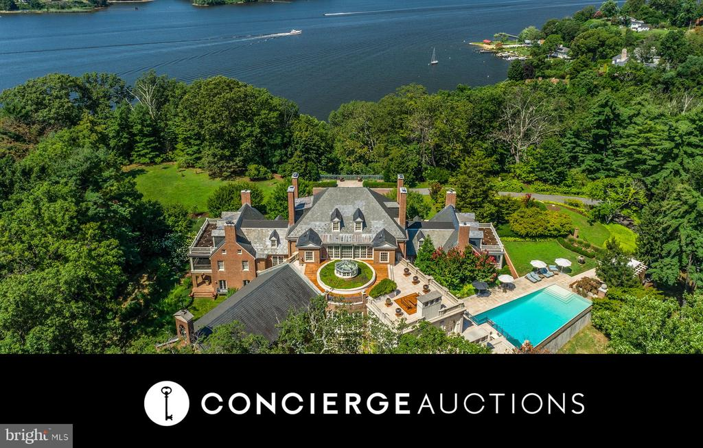 AUCTION: Bid Aug 12–18. Currently $24.9M. No Reserve. Showings Daily by Appt.   The Friary, a 35,000sf Georgian Revival mansion minutes from downtown Annapolis, is an iconic renovated estate that pays homage to its Georgian roots without sacrificing any comfort necessary to live and entertain in luxury. The views of the Severn River & ideal proximity to the nation's capital & Baltimore offer incredible appeal. Step into the main core of the house, where 18th-century elements, like original heart pine floors & foyer arch moldings, have been flawlessly preserved. A cleverly designed limestone rotunda containing a conservatory & atrium lead to either of the house's wings: the impeccably appointed guest wing with spacious common room, or the chapel-turned-ballroom with sweeping limestone fireplace, herringbone teak floors, & arched double doors with a picturesque terrace beyond. The commercial-sized gourmet kitchen & second catering kitchen make entertaining on any scale a breeze.
