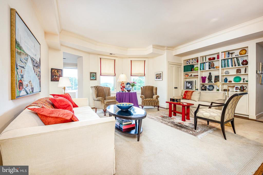 Step into the beauty and elegance of a bygone era at the St. Nicholas in the heart of Kalorama. Built in 1917, this boutique, 31-unit Beaux-Arts style condominium features six floors of luxurious and uncommonly spacious residences. Maintaining so much of its original charm and detail, unit 4AW is a 1,885 square foot home with hardwood floors, soaring ceilings, a captivating sunset and Cathedral views, a wood burning fireplace, and in-unit laundry. With a gracious entry foyer, separate living room, formal dining room, eat-in gourmet kitchen, primary bedroom suite with a wall of closets and a library/second bedroom and second full bath with tub, this condo truly lives like a home. Building amenities include a live-in porter, exercise room, additional separate storage, and trash/recycling pickup from just outside the unit kitchen door. Premium garage parking space also conveys. Welcome home!