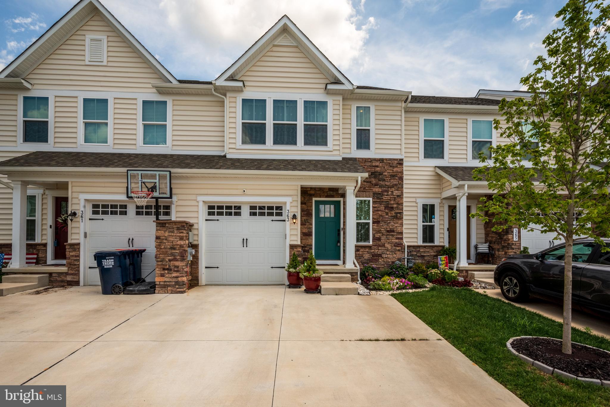 No need to wait until 2022. This LIKE NEW Luxury Roxbury Model in the popular Preserve at Deep Creek, built in 2020 will not last long. Title Policy less than 5yrs may be transferable to buyer and save buyer money. This beautiful townhome has a partial stone front, covered front porch, 3 Bed, 2.5 Bath, with the 6ft Extension, Finished Basement, 1-car Garage, Security System, 30yr Roof Shingle, concrete driveway. Make note this home includes many Premium Features selected at new construction and done post settlement; a benefit of buying a pre-owned home. This community HOA includes Lawn Maintenance!! This grand floor plan offers a lot of natural sunlight. This home is also near multiple communal parking lots, perfect for guests. The MAIN FLOOR, enter the front door into the warm foyer with curved staircase to the right leading to the upper floor, walk forward to the main level and notice the wide-plank LVP flooring throughout the Foyer, Hall, Powder Room, Kitchen, Dinette and Pantry. Beautiful Kitchen with Quartz Countertop and accented tile backsplash. Large Island with Double Sink, Barstool Seating, Recessed Lighting, and a Pantry. The main level has an Open Floor plan between Kitchen, Dining Rm, and Family Rm. The Family Room has a sliding door to the backyard and a Composite Deck  (approx. 12x11) and steps to the yard. Completing the main floor includes the Powder Room and door to the Finished Basement. The UPPER FLOOR has an Elegant Owner'sSuite with Tray Ceiling, Two large closets (one is a walk-in with a front window), Luxury Owner's  Bath with a tiled shower and and bench, glass door, dual shower heads, dual sink vanity with marble countertop, separate toilet room, and a linen closet. Two additional bedrooms and a full bath with tiled shower with tub, single vanity with marble counter. The Laundry Room has Shelving and a Laundry Sink, and a Linen Closet, complete the upper level. The FINISHED BASEMENT adds great value and interior square footage and hosts a w