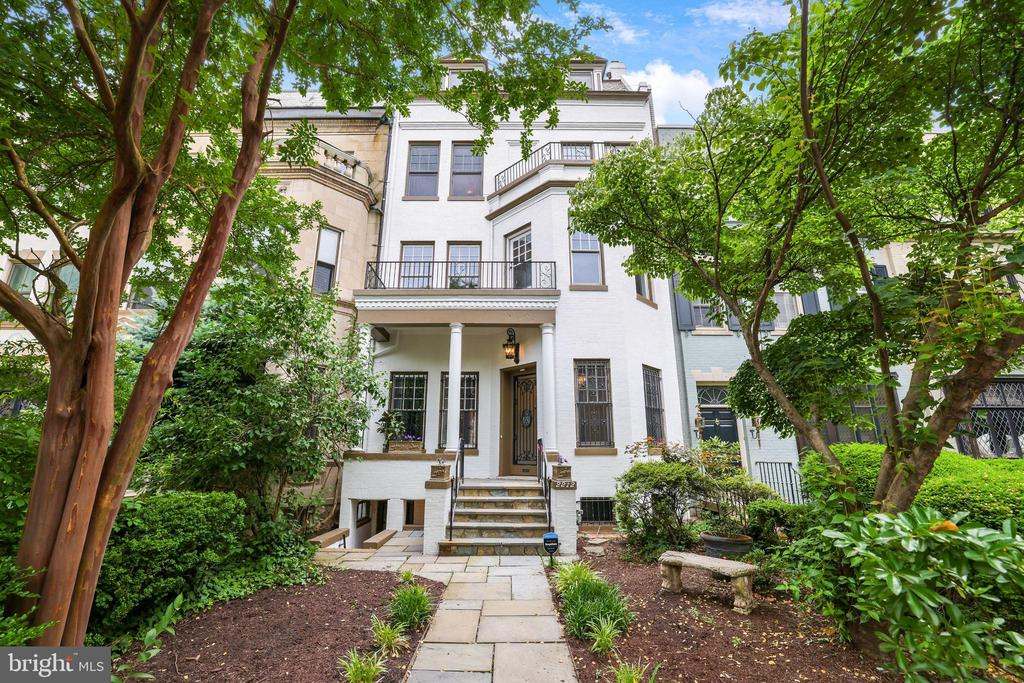 Don't miss this special opportunity to own a historic piece of Washington DC . This elegant 1916 landmark Victorian style property is located in the heart of Washington DC's most prestigious Kalorama neighborhood, on Embassy Row, and is walking distance to Dupont Circle and Georgetown. This newly renovated 5-story residence includes a separate walk-out basement unit, and an Au Pair unit on the top floor.  Original designed woodwork and spacious layout, give it unique character, and functionality.   The large townhouse has 5,700 square feet of living space. On the main-level you will find an octagonal lobby, with high-beam ceilings, luxurious chandeliers, intricate wood beams, and  wood-paneled hallway which leads to a one of kind living-room with its original wood and plaster moldings and a fireplace. Next, on this level you will find a banquet-size dining room with built-in wood and glass cabinetry, and another fireplace. To the right of this gorgeous dining room is the renovated kitchen with stainless-steel appliances and large size gas range. The main-level also includes a powder-room with beautiful mosaic tiled walls.  On the second floor, you will find, a spacious master-suite which includes a large living-room area with built-in shelves (can be used for office space or another bedroom), and a bright bedroom with a large size-full renovated bathroom (includes a bathtub, and a shower). This level also has a sit-in balcony that faces  the beautiful views of Embassy-Row.  On the third level you will find a gorgeous large room with built-in shelves and storage that can function as a library, office space or a bedroom. Along this, there are 2 additional bedrooms on this level with their own walk-in closet and a full bathroom. Also, a laundry room is conveniently located on this level.  The fourth level has an airy ample-spaced studio-suite, with a full-bathroom, and a separate kitchen.  In addition to the four-levels, this residence has a basement with its own separ