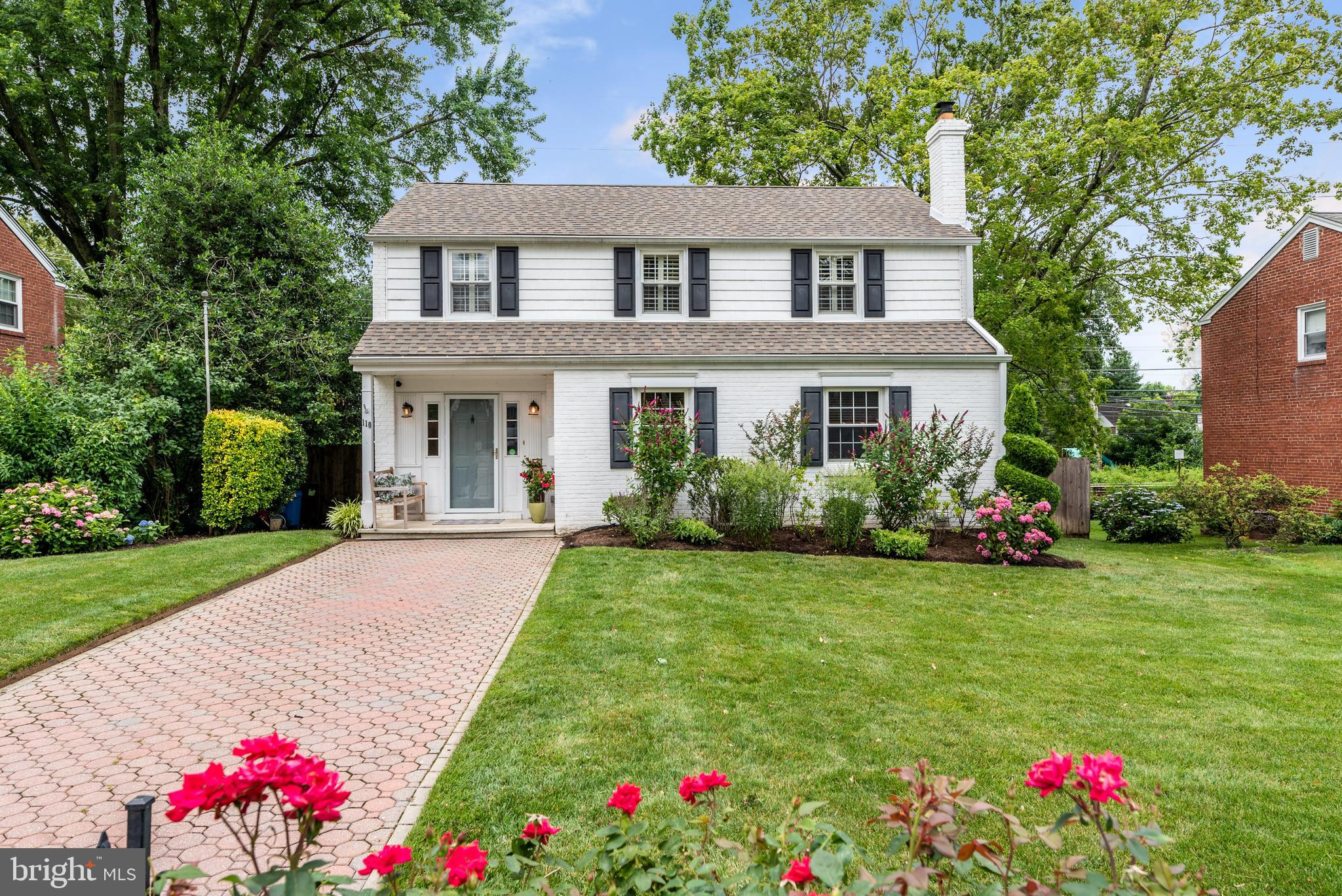 Welcome home to this charming and updated 3 bedroom, 2.5 bath home in the Old Oaks neighborhood of Bryn Mawr. The mature landscaping and paver driveway make this home a total showstopper. Enter the front door to be greeted by tile floors and a beautiful built-in cubby area for storage. A spacious living room sits to the right of the front door and offers a gas fireplace, hardwood floors, abundant natural light, and a built-in bookshelf. The living room is open to the dining room and kitchen area. The kitchen which was recently renovated has blue and white cabinets, granite countertops, a subway tile backsplash, stainless steel appliances, ample counter space, and counter seating. First floor laundry and a powder room complete the first floor. The second floor offers 3 spacious bedrooms and 2 full bathrooms. The primary bedroom has carpet, plantation shutters, and 3 closets including a custom walk-in closet. The secondary bedroom has an abundance of natural light, plantation shutters and an updated ensuite bathroom. A spacious third bedroom and tiled hall bath with a shower/tub combo complete this floor. The partially finished basement is the perfect space for a playroom or home office, you will also find an additional unfinished storage area in the basement. A two tier deck will make entertaining breeze, there is even an outdoor TV area! The fully fenced backyard has an additional seating area, storage shed and landscaping throughout. 110 Buckingham Drive is in the award winning Radnor School District and within walking distance of the R5 Septa train and the R100 Speed Line to make commuting to Philadelphia extremely convenient. Also, within walking distance is to the recently renovated Clem Macrone Park. You can easily access the popular shopping and dining districts of Bryn Mawr, Villanova and Wayne as well or hop on the Blue Route in Villanova. The Old Oaks Neighborhood is truly a gem - block parties and movie nights are just a taste of what this amazing neighbor