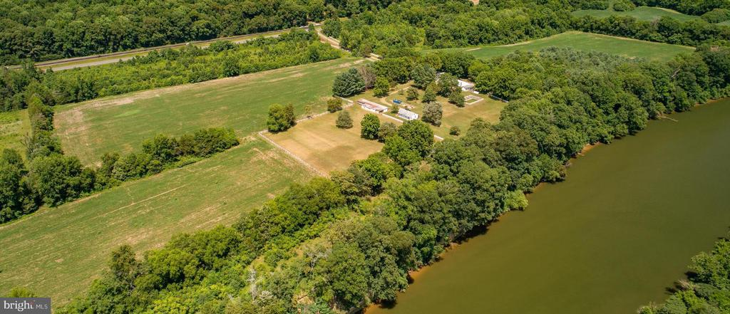 Private Waterfront Estate,  45 ACRES with STUNNING VIEWS! This is an amazing opportunity to own 45 acres on the Rappahannock River, just 5 miles from downtown Fredericksburg! 1700 feet of river frontage with river access.  Potential  for Equestrian estate, winery,  you name it, possibilities are endless! Full Solar and Geo thermal potential.  Fenced pastures. Land use.  3 wells on the property.  200 year old irrigation ditch.  ALL Buildings on the property and the in-ground pool are being sold AS-IS.  Buildings include a 4800 Sq ft historic home, Adorable 2 BR Guest house , 100' x 100' Tin Barn, poultry house, Covered shed and separate workshop. Tractor Conveys. Boat and outdoor gym DO NOT convey.  2 parcels.