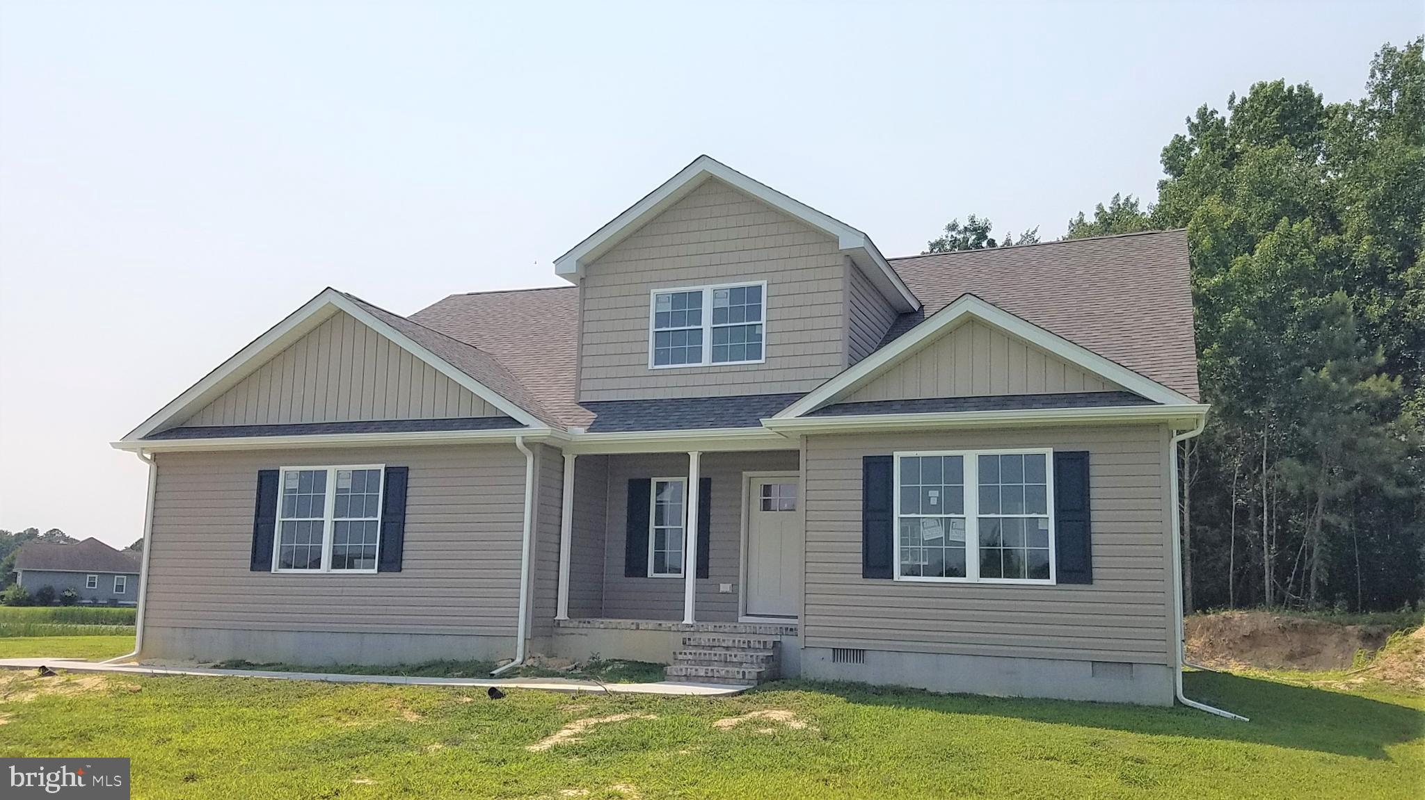 New Construction - Almost finished on over 10 acres to the rear of the home. Open area living with expansive ceiling in the living room.