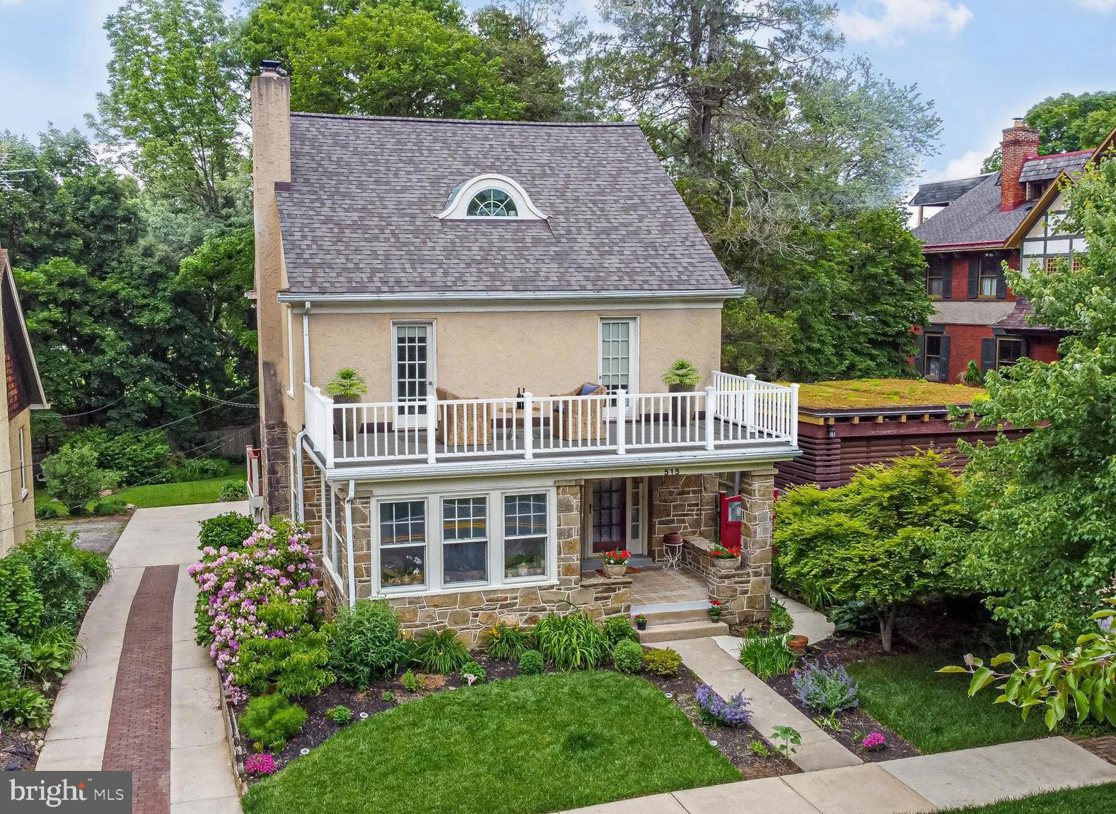 """NEW ROOF DECK INSTALLED & IMPROVED PRICE! A beautifully preserved 1920s bungalow-style home is a prized example of West Chester's historic charm. Facing Everhart Park, this borough gem offers all the park's charm and tranquility.  A welcoming front porch leads you into a spacious living room showcasing gorgeous original oak hardwood floor. A beautiful key-stoned fireplace with a wood stove cast-iron insert provides warmth on cozy winter nights. The stove also has a capped gas line in case you would like a convenient gas fireplace. To the left, enter through beautiful artisan-built French doors into a glass-enclosed sunroom and view the tranquility of the park's beauty.  The second set of French doors opens into a spacious private dining room appointed with original arts and crafts brass lighting fixtures, showcasing a handcrafted built-in glass corner china cabinet. The room provides a plentiful number of windows with views of the rear deck and spacious yard. Make a right turn through the swinging door into the stunning updated kitchen featuring granite countertops, 42"""" custom cabinetry. modern recessed lighting, and a center island, all on the original restored hardwood flooring. The kitchen offers a bonus feature, a custom built-in breakfast nook, a spacious area where you can relax with a cup of coffee. Through the French door is a large custom-built mahogany deck (2014) with two-toned white cedar piers that overlook a beautiful private backyard and Horace Pippin Park!   Under the deck is a built-in potting shed for all your garden needs. The second level offers three bedrooms.  It boasts of one very large bedroom with a built-in window seat and two French doors that take you onto a unique front sundeck that overlooks a gorgeous view of Everhart Park, and a place for you to sit and enjoy your favorite cocktail.  In addition, there is a second sizable bedroom for family or guests, and a third bedroom that could also be used as office space that gives access to a b"""