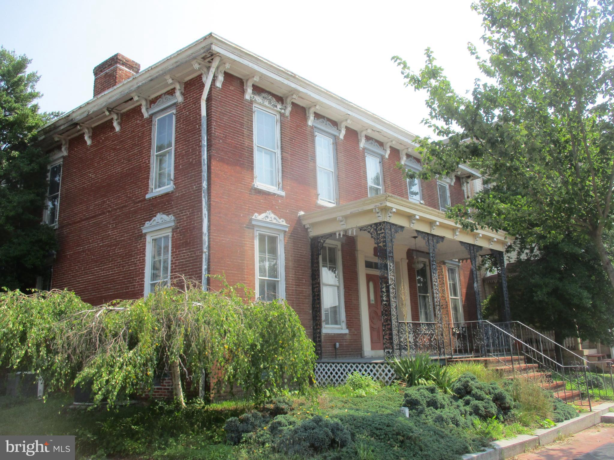 Price Reduced! Italianate style two story brick mid 19th century structure. Has been a residence, a restaurant, and last used a residence and antique store. Listed on the National Register of Historic places this property contains many features such as ornate wrought iron porch trim, decorative lintels above windows, high ceilings, fireplaces, and more. If you love old homes and have the energy and vision to restore it to it's former glory then this may be the house for you. Sold as-is.