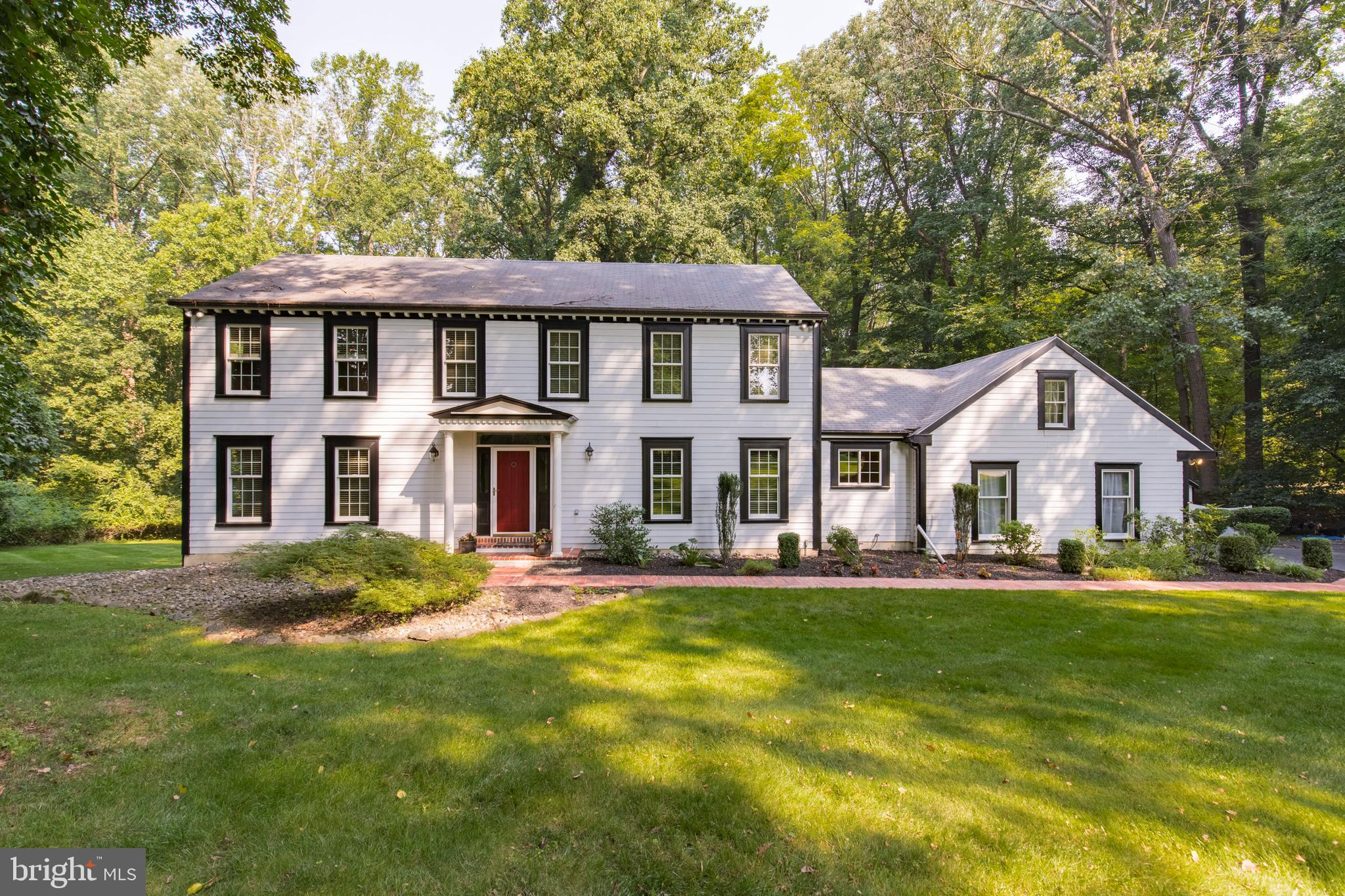 Stunning Penn Oaks Estate beauty.  Move in ready 4 bedroom, 3 1/2 bath home in the coveted neighborhood of Penn Oaks Estates. Greeted with brick paver driveway entrance, flanked by stone pillars with lights.  Mature landscaping and a brick paver walkway take you to the front door.  First floor has hardwood flooring the family and dining room are newly refinished. Two coat closets, a half bath with tile flooring and granite counter top vanity. Front to back living room, with a coffered ceiling and recessed lighting. Family room has a wood burning fireplace with brick surround  and oversized mantle. Another sliding door takes you to the 2 tier deck.The dining room has a new light fixture, crown moulding, coffered ceiling  and wainscoting. Eat in kitchen offers granite counters, cook top,  GE profile double ovens  and a touch free faucet. The sliding door leads out to the 2 tier deck and the fabulous back yard with an Anthony Sylvan pool.  Up the curved staircase takes you to the 4 bedrooms and hall bath. New carpeting on steps, hallway and primary bedroom. Large primary bedroom  has ceiling fan and recessed lighting, the  primary bathroom has a  3 sided shower, soaking tub, dual vanities with Corian counters and custom cabinet also with Corian. Three other bedrooms all have exposed hardwood, ceiling fans and ample closet space. The finished, walk out lower level has new carpeting, work out area and another family room, full bathroom with tile and a walk in shower, which is great when coming in from the pool area. Corian counter with sink and fridge. Large storage area completes the lower level. Home has been freshly painted in neutral colors, most of the windows have been replaced with Renewal by Andersen windows and sliders.   Hardi plank siding, Enjoy your summers in the Anthony Sylvan pool. This home is a winner!