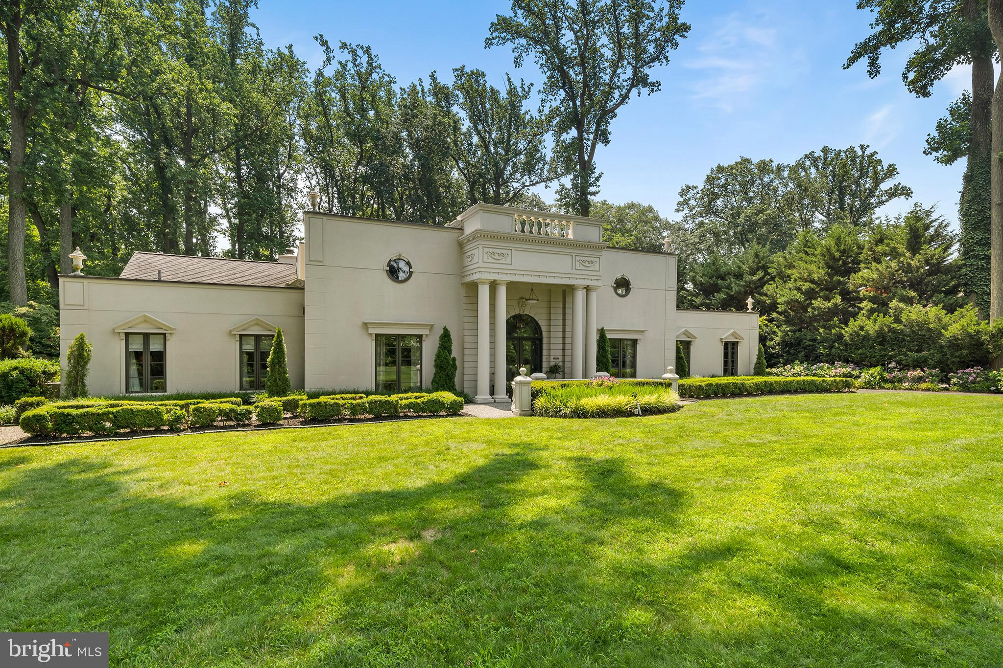This 5 bedroom, 3 and a half bath residence located on Ridgewood road has rightfully been recognized in top design and décor publications for its stunning sophistication and 'Old Hollywood' style. Located on over 1.3 acres of land, this property boasts a formal garden complete with roses, boxwoods, hydrangeas and the towering presence of tulip poplars. Upon entry, guests are treated to a custom designed two story foyer painted by artist Alix Jacobs, featuring a black and gold turning staircase. The adjacent formal living room offers great natural light with views of the pool and access to the garden in addition to its wood burning fireplace. Also located on the main floor is the home's master bedroom, its accompanying marble floored bathroom and his and her walk-in closets. The master sits just feet away from a small library, a cozy den area, and a skylit kitchen with patio access. Outfitted with Gaggenau appliances, Bulthaup cabinetry and tastefully hidden appliances, this kitchen is any chef's dream. Migrating upstairs one finds an additional three bedrooms and two full baths, perfect for children and/or guests. Each bedroom has a great view of the garden/pool area below, with an upstairs sitting room having floor-to-ceiling windows for outdoor viewing pleasure. Outside the residence, owners are able to entertain on a sprawling flagstone patio, or in the in-ground salt water swimming pool. Located in the heart of the prestigious Lower Merion school district, this property is just minutes from the shopping/culinary offerings of the Main Line, all while being just a 20 minute commute to Center City Philadelphia.
