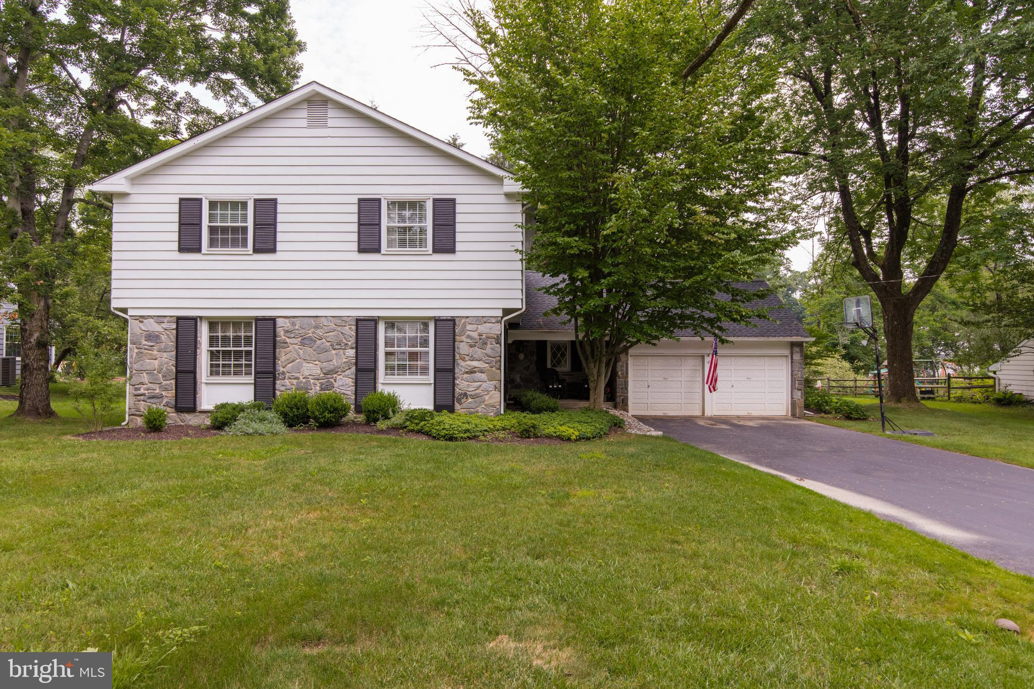 Welcome to 595 Watford Lane in the desirable Devon Downs neighborhood! Walk to Devon Yard (Anthropologie, Terrain, Amis Trattoria), the Devon Horse Show and Septa Devon Train Station. Close to major highways, the Farmer's Market and all the Main Line has to offer. This 2-story Colonial on almost a half acre private lot is every host and hostess' dream!  Enter from a covered front porch into the center hall which leads to the living room and dining room with hardwood floors, the family room, the kitchen and the upstairs...a perfect layout for your holiday parties. Off the kitchen is a delightful sitting room with cozy gas fireplace, a lovely place for morning coffee or a glass of wine, and is truly the heart of the home. The sitting room also overlooks the back patio and fantastic back yard. Round the corner to the first floor full bathroom and family room with sliding glass doors to the back patio. The first floor laundry room has built-in cabinetry and access to the two car garage with garage door opener and plenty of storage. The second floor has 4 Bedrooms plus 1 Bonus Room and 2 Full bathrooms. The owner's bedroom has an en suite bathroom and walk in closet.  The backyard has beautiful landscaping and trees and leads to a cute stream to explore {See Flood Survey attached!} This home is where memories are made!