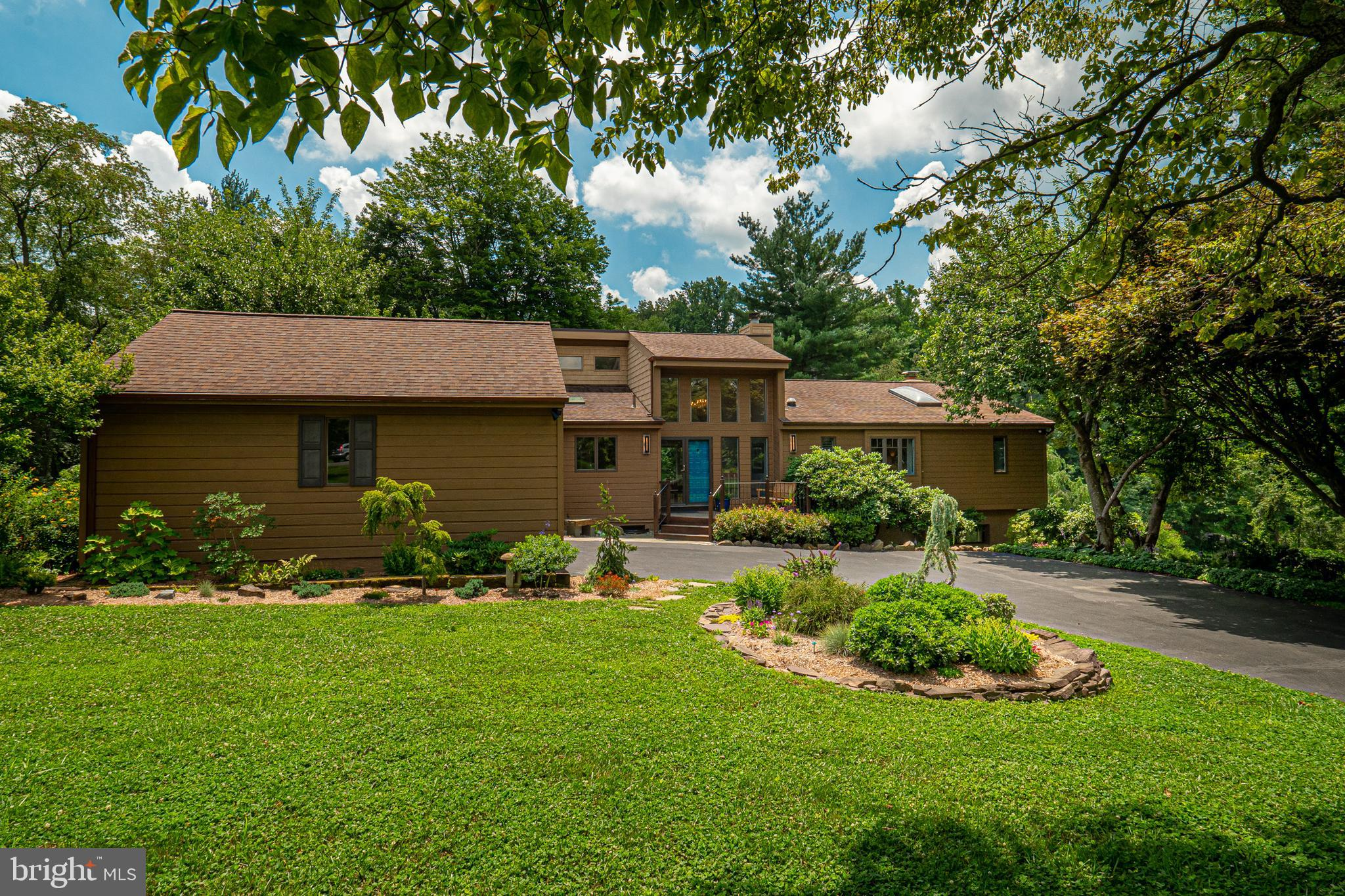 Sunday open house 7/17 from 1-3 pm has been canceled. Be prepared to fall in love with this light-filled, spacious 5-bedroom, 3 full bath home in the award winning Unionville Chadds Ford School district.  As you enter the two-story foyer you are greeted with gorgeous views of the lush green open space that surrounds this home.  Step down into the living room with vaulted ceiling and fireplace, the floor plan flows easily to the lovely dining room, open kitchen and the sliding doors that lead you out to the amazing deck which has plenty of space to relax and enjoy the outdoors. This home provides one story living as 2 of the 5 bedrooms are on the entry level.  The large main bedroom has its own deck and a delightful bathroom with walk-in shower and soaking tub.  The lower level has the perfect flex space.  The downstairs family room with fireplace opens onto the brick patio which is the perfect place to entertain and watch the sunset.  Three additional bedrooms, a full bath and lots of storage complete this wonderful flex space. Don't forget to check out the heated garage which is easily accessed through the mudroom laundry area.   Some of the outstanding features of this home include: Geothermal HVAC installed in 2014, gutter guards, new roof in 2014, New 100 gallon water heater, freshly painted entire interior including trim, New granite and Corian countertops in kitchen, New range, New microwave, New Dishwasher, New washer and dryer, New granite countertop in upstairs hall bath, New carpets throughout, New flooring in kitchen and gym, New fixtures /hardware throughout multiple bathrooms and kitchen, Newly installed central vac system, Newly installed partial house generator system and New hardscaping in front and side of house and landscaping. Lastly new Pella windows to be installed August 17 (2 in rear of house, one in front window and one in master bath).