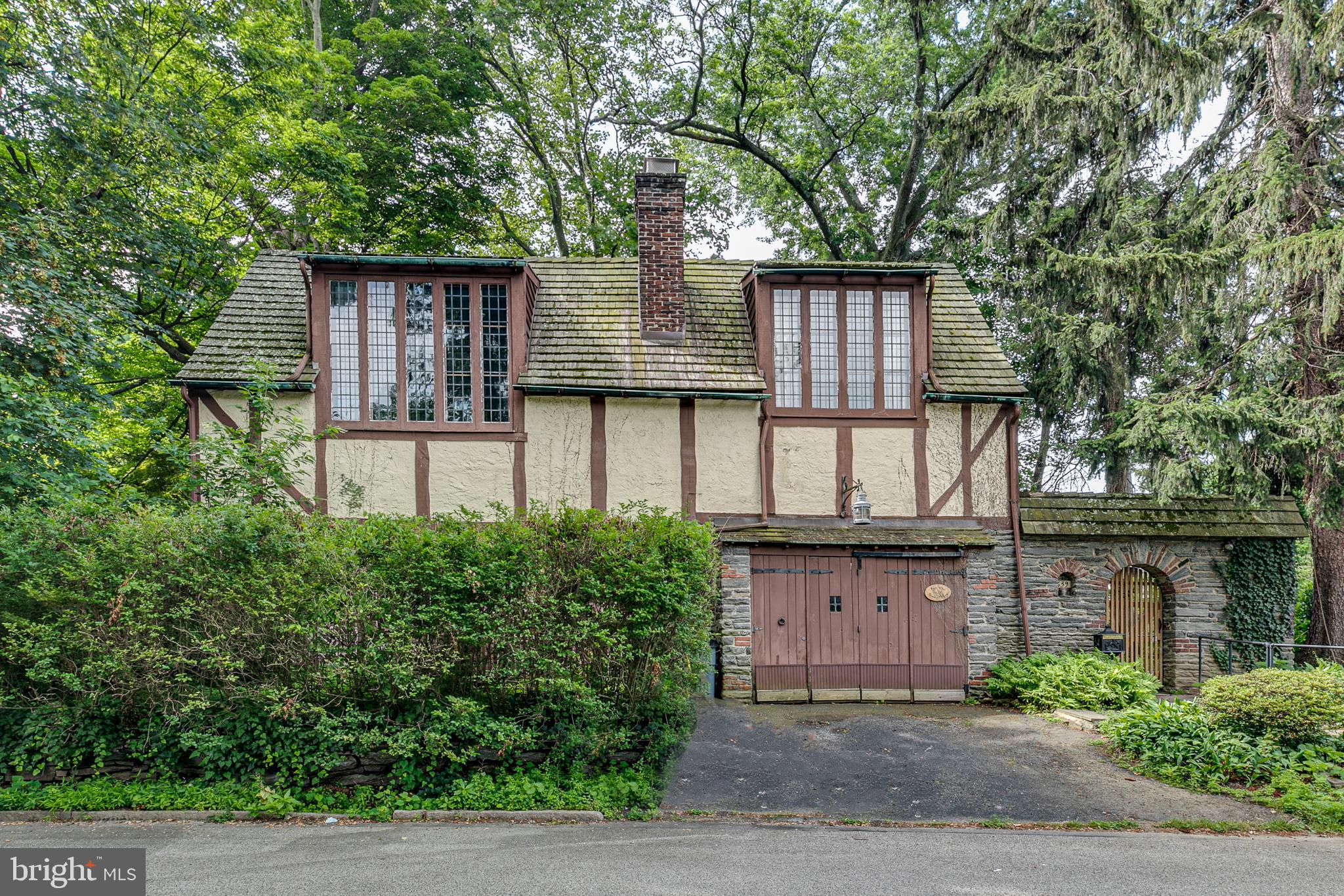 FOR SALE: Rarely offered single Tudor-style home in historic English Village in Wynnewood, Lower Merion Township. 2,331 sq. ft. 4 bedrooms, 1 full bath and 1 half bath home with a large back yard. Sun-filled living room and dining area. Two large bedrooms with cathedral ceilings, and two additionally nicely sized bedrooms. Large kitchen with slate tile floor and stainless steel appliances. Gas cooking. Dining room features exposed beam and door to outside patio where you can view the pond.  Basement features large separate wine cellar, as well as washer and dryer. Attached one car garage and extra parking space outside of the garage. Convenient to Wynnewood Shopping Center, Suburban Square and R5 train station.