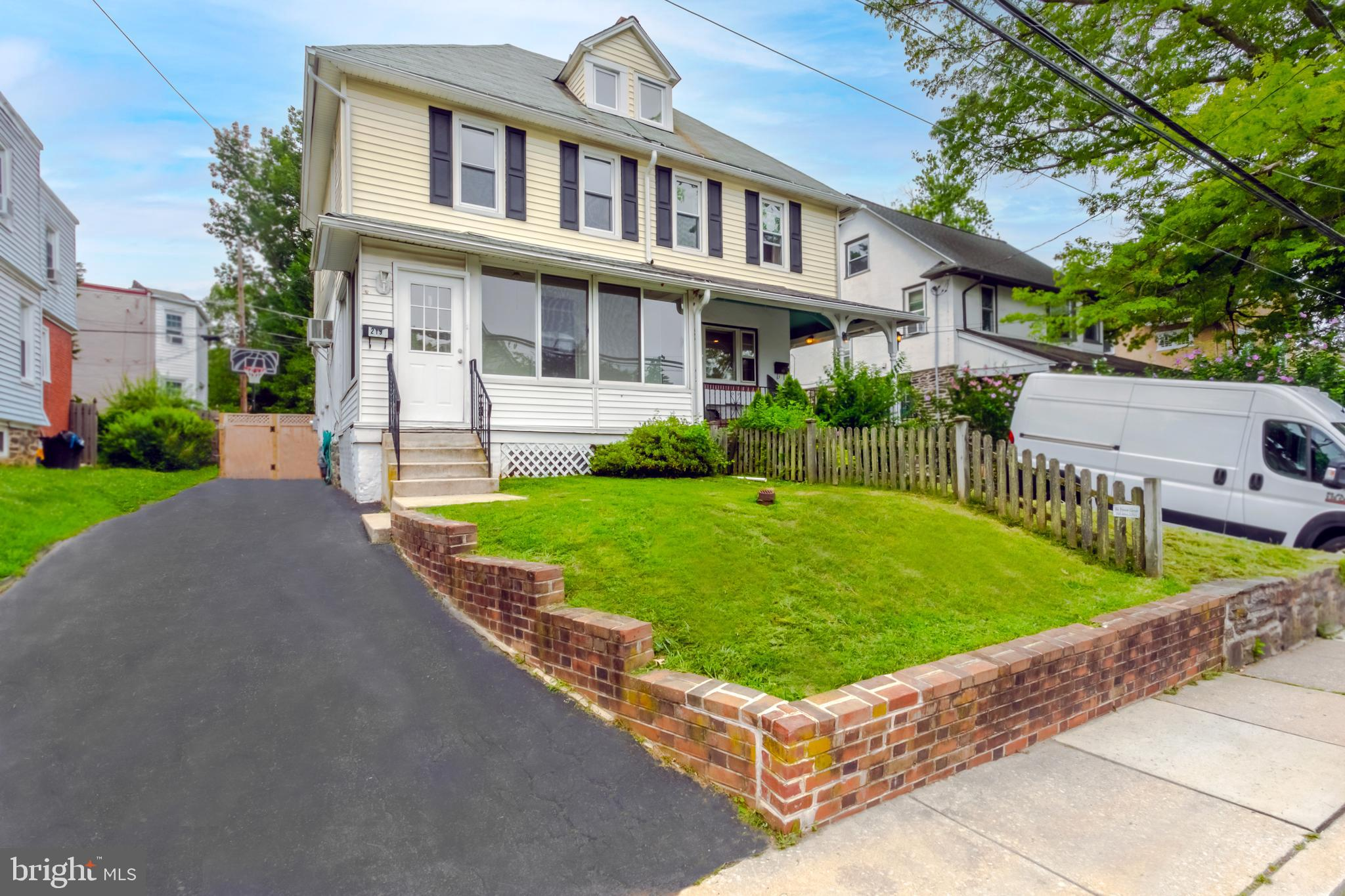 """Location, Location, Location!  Welcome to 219 Iona Avenue located in the heart of the coveted Narberth Borough and desirable Lower Merion School District!  This charming twin home is just a short walk to everything you need!  Pull into the private driveway and enter the home through a sun-filled enclosed porch.  The home's first floor boasts an open flow extending from the living room directly into the dining area and kitchen.  Directly off the kitchen is a brand new """"Trex"""" deck - perfect for everyday living or entertaining.  The current owners also just installed a brand new, beautiful outdoor shed in the private and fully fenced backyard.  The partially finished basement includes a home office,  seating area,  powder room, and laundry and utility area.  The second floor of the home features a sizable primary bedroom, with two additional bedrooms and a full bathroom.  The third floor includes a """"bonus"""" bedroom which could also be used as a home office or playroom.  Beautiful hardwood floors flow throughout the home.  This home and the ultra-convenient location offer all the benefits of Narberth including a short walk to the R5 train line to Center City Philadelphia, a wide variety of shops and restaurants, a library,  playgrounds, and much more!  Schedule your showing today!   Showings begin Friday, July 16th."""