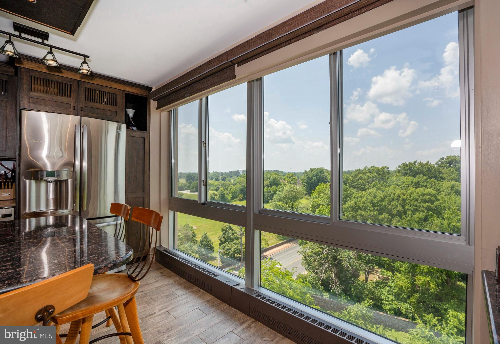 Imagine yourself in this rare and extremely large 3 bed and 2.5 bath luxury condominium.  Over 2,400 sq feet with 2 balconies - one off the master suite.12th floor views of West, North AND East allows you to enjoy the sunrise and the sunset over Rockford Park.  From the moment you arrive in the foyer, you see the abundance of natural light in the spacious living room with wet bar.  There is a large dining room with sliding door to 1st of 2 balconies.  Then enter the state-of-the-art kitchen with custom cabinets and granite.  A large center island, wine rack, and stainless appliances are just some of the features in this gorgeous kitchen.  The bedrooms are beyond the living room.   Two nicely sized bedrooms across from a full bath with high end finishes.  Then onto the master suite retreat.  The spacious bedroom has it's own balcony space.  There is a dressing room area with multiple closets on the way to the master bath with it's dual sink vanity and double sized shower with all beautifully tiled and appointed.  There is also a dedicated laundry room with full size washer & dryer along with a utility sink.  There are 3 indoor parking spots available for purchase if buyer has interest.  This is a one-of-a-kind unit in The Devon which offers all the amenities that a condo building affords: 24/7 doorman, 3 elevators, swimming pool, private parking lots, newly updated library.  Plus the lobby and hallways are newly renovated all with modern decor.  The Devon is perfectly situated.  Only 5 blocks to Rockford Park and 2 blocks to Lifelong Learning Center.  Only 1/2 mile to Trolley Square with shopping and restaurants.  Close to 95 for travel North & South.  Schedule your tour today!  The condo fee is based on 2480 sq ft.
