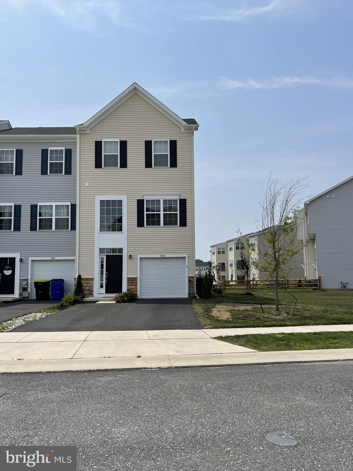 Seller will need November 22, 2021 Settlement Date. WELCOME to 1085 Wickersham Way (Tydings model)This 3 story extended Townhome features an exquisite foyer with Weathered colored hardwood flooring as you enter the lower level. Enter into the main door to the lower level down the hallway to  bedroom #4 or use as a family room, workout area, home office, make it your choice.  It's all up to you!  Walk upstairs to the 1st level where you will find a spacious kitchen area and more hardwood flooring! The kitchen features Moon White granite on the island with double sink, and the countertops which offers a pop of color against the Espresso colored cabinets, all stainless steel kitchen appliances to include natural gas cooking, microwave, refrigerator and dishwasher and pantry. The great room and sunroom are places where you might entertain your guests and offers tremendous natural light. A powder room is on the main level as well. We then walk up to the 3rd level where you enter your Primary Bedroom! There you will find a sitting room where you might lay on your chaise for a daytime nap! The master bathroom features Cabo Coast ceramic tile on the floors and surrounding the shower. The hall bath, along with 2 other bedrooms and the laundry room are on this floor as well.  Laundry room located on the 3rd level, no more lugging the laundry up the steps!  The Hyett's Crossing community is home to over 70 acres of open space and this homesite backs up to open space and is located steps from overflow parking.