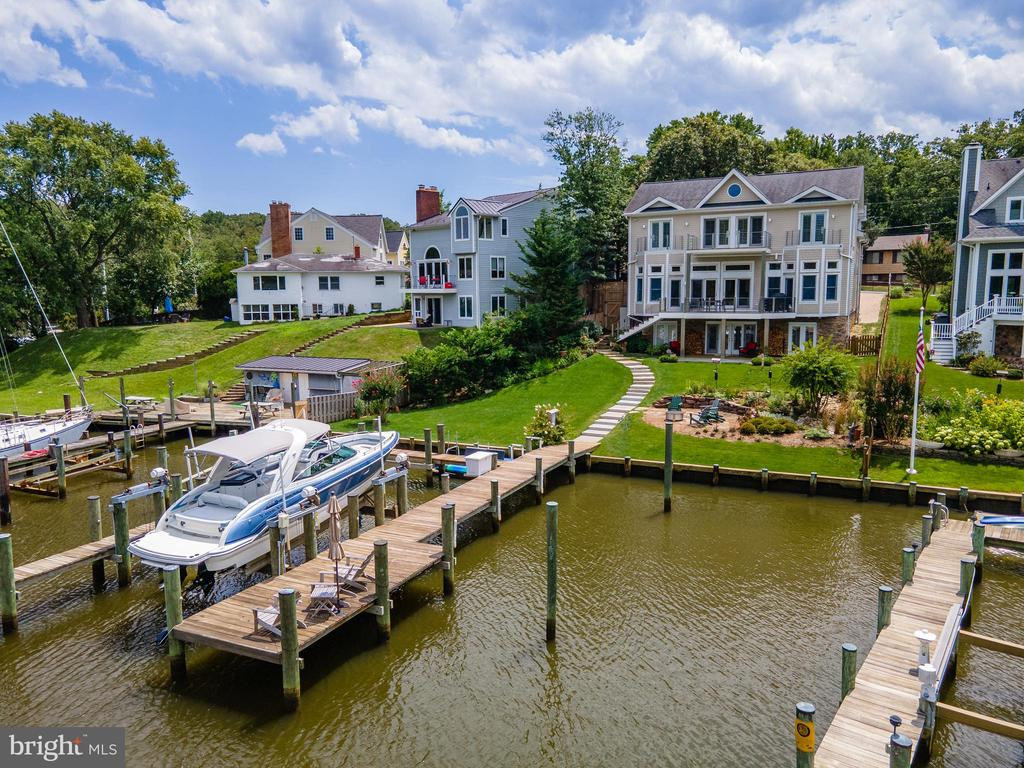 Exceptionally built custom waterfront home with spectacular panoramic views of Spa Creek.  Attention to detail and high-end finishes are the hallmark of this wonderful home with 12 ft ceilings on the main level.  Over 4,500 sqft of living space on 3 finished levels, 5 spacious bedrooms and 4 baths including the newly remodeled Owner's bath with freestanding soaking tub, glass enclosed shower and custom built vanity.  Other recent improvements inside include new Carrara marble kitchen counter and backsplash, interior accent lighting, reconfiguration of stairs to garage, soapstone slab in entry way, and hardwood flooring in office.  Outside improvements include, expansion of waterside deck and stairs for access to backyard and pier, enlarged stone patio, complete remodel of backyard including all new sod and landscaping, underground irrigation system, stone walls and stairs, and waterside firepit area.   The open floor plan encourages indoor/outdoor living and draws you outside to relax on the spacious Ipe deck with modern stainless steel cable railing and elevated views of the water or encourage the party to spill out onto the custom stone patio below and  the lush backyard that leads out to the pier that will be sure to please any boating enthusiast.  New in 2016 the dock features 4 slips, 2 lifts (40,000 lb & 8,000 lb), floating pier, water/shore power and even wifi.   Grab a water taxi directly from your dock and head down Spa Creek right into Annapolis for a night out on the town or venture off to some of the Bay's best cruising and fishing areas.  Annapolis offers the perfect balance of small-town charm and big world sophistication.  Be sure to view the HD Video Tour.  Welcome Home!
