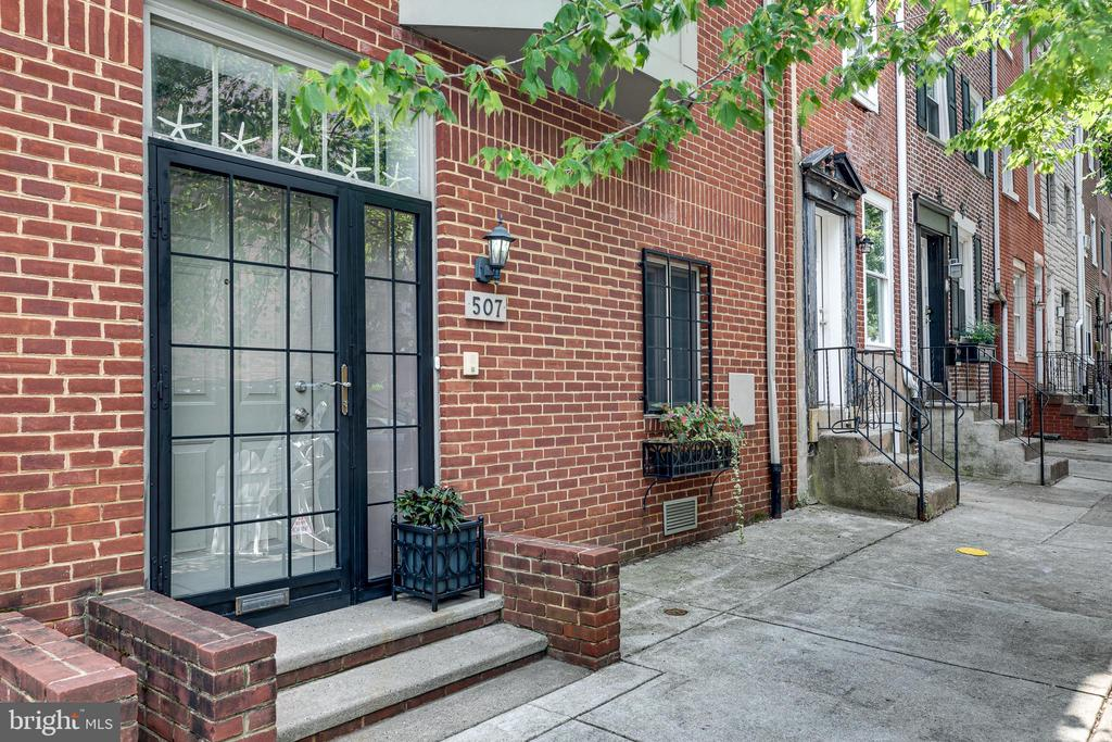 Welcome to 507 S 27th Street, in the heart of Fitler Square! This is a 3-bedroom, 2.5-bathroom townhouse with TWO car parking. The first floor consists of a foyer, coat and storage closet, and home gym/office space. There is also an entry to the secure garage with plenty of space for storage. A private gate encloses the garage, and there are no HOA fees.  The second floor has a spacious open floor plan that offers 9-foot ceilings, a gas fireplace, and a custom-built bookcase. This floor features the living room and floor-to-ceiling patio sliders that lead to a deck perfect for alfresco dining and entertaining. Through the living room, you meet the dining room, large enough to host friends and family for the holidays. The kitchen is situated with gorgeous bay windows that drench the room with natural light and overlook the green space across the street. The kitchen also features white cabinets, granite countertops, a breakfast bar, a hooded stove, and updated appliances. A powder room is also conveniently located on this level. On the third floor, there are two large bedrooms, a full bathroom, a laundry area, and a linen closet. The top floor consists of the private owner's suite which offers a full bathroom with a walk-in shower and a dual sink vanity. It also has a walk-in closet and sliders that lead to the deck with picturesque views of the city.  This beautiful townhouse is located just one block from the Taney ball dog parks, a community garden, access to the Schuykill River Trail, and much more. This home is also located within walking distance from UPENN, CHOP, University City, Fitler Square, Rittenhouse Square, and South Street so you can enjoy all the wonderful local amenities.