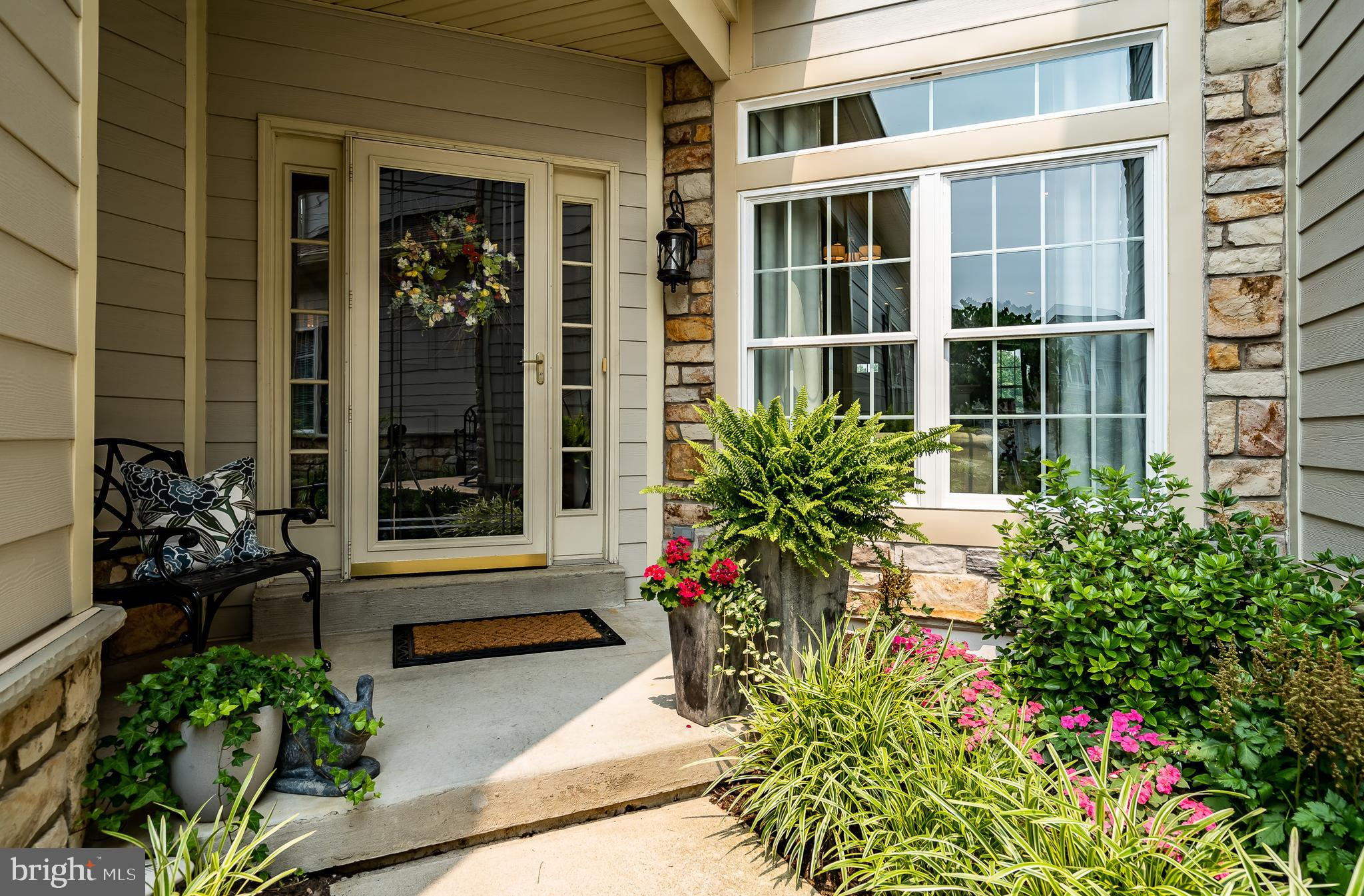 """Look no further for the perfect move in ready townhome in the much sought after """"hidden gem"""" known as the Greens at Penn Oaks.  Location, location, location and this home has it!  The views and magical sunsets from one of the largest decks in the community which overlooks the 10th green, is perfect for entertaining and large  family gatherings.  The welcoming foyer opens up to the formal step down living room and dining room both with hardwood floors, crown molding and wainscoting. The kitchen boasts modern subway stone backsplash, stainless steel appliances, including new stainless hood, built in microwave, GE Profile gas range, granite countertops with a new contrasting  Quartz countertop on the island and flows nicely into the cozy family room with double sided gas fireplace, wainscoting, crown molding,  and French doors to the new Trex deck with privacy walls and a retractable awning. The hardwood floors that grace  the first floor continue to the second floor.  The second floor primary suite has  a gas fireplace in the sitting area, large walk in closet with custom closet system and a large, light filled bathroom with his and her sinks and custom plantation shutters. There are two additional good sized bedrooms with large closets, one being a walk in, with newer neutral carpet.  Also on this floor is a convenient laundry room with built in ironing board!  The lower level adds approximately 600 additional square feet of living space, a full bath with stand up shower, built ins and desk area, custom lighting, two large unfinished storage areas and the owner had this space fully soundproofed.  All lighting fixtures in this home have been updated and many were purchased from Lighting by Design.  There is a two car garage, two driveway spaces and plenty of guest parking available.  New hardy plank siding, a new roof, new A/C, mostly new windows, and a new hardscape patio off the deck have all been done in the last few years.   The low monthly association fee include"""