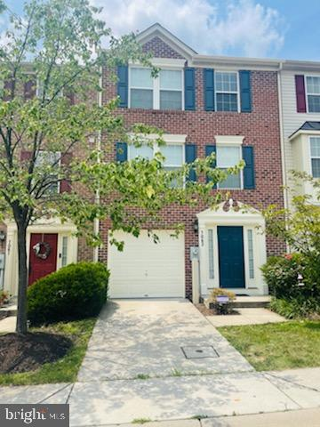 Spacious 2,100 SF brick front 3 level townhome with one car garage!   Freshly painted throughout  Garage access from main level with half bath, family room and door to rear yard   Large eat-in kitchen with center island, breakfast bar and pantry   Living room and sunroom both have hardwood floors!   Master bedroom with walk-in closet and full en-suite bath with separate shower & dual vanities   Two more bedrooms and full bath   Condo fee covers lawn, roof replacement and exterior maintenance   Convenient to commuter routes