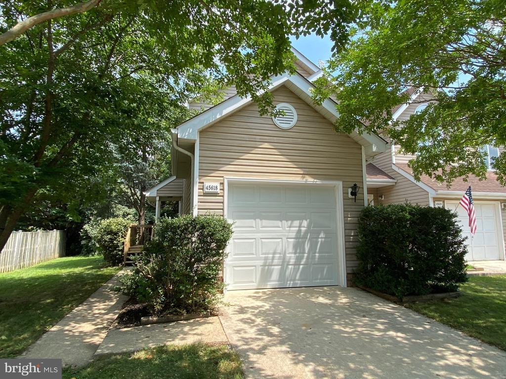 End unit townhouse with 3 finished levels.  New roof.  Hvac replaced in 2016-2018. Siding  & garage door were  replaced.  Freshly painted.  3 1/2 baths.   Laundry room & storage room.   Private back yard.  Furniture can convey.