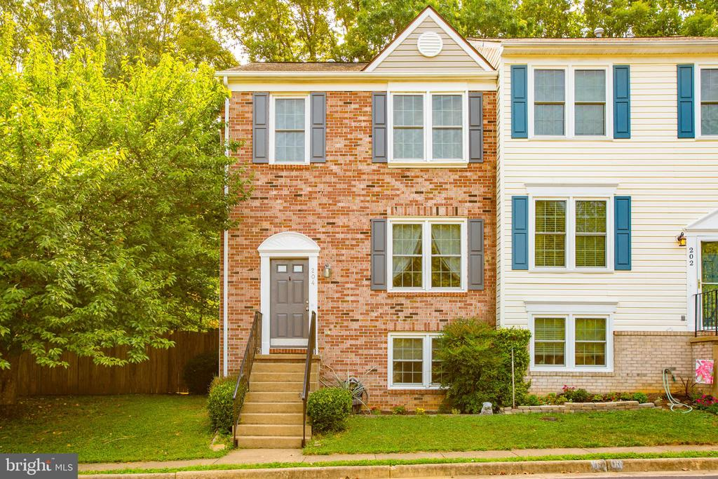 Updated and move-in ready in a fabulous location. This brick front, end unit townhome is what you've been waiting for.  As you enter the front door, you'll notice the Luxury Vinyl Plank (LVP) floors immediately.  Walk up the steps to the family room with large window featuring LVP floors as well.  The kitchen features granite tile counter tops, backsplash, updated appliances, white cabinets, a pantry, a breakfast bar and an eat-in area.  The sliding glass doors lead out to the deck with plenty of space for your smoker or grill and to entertain.  The deck steps lead down to the fenced in back yard. Upstairs, there are 2 large masters with vaulted ceilings.  The hall bath has been updated and features a tiled shower/tub combo.  The second master features a half bath en-suite and a walk-in closet.  The vaulted ceilings of both bedrooms brings in extra light and unique architectural features. The lower level features a family room with wood loom Italian Ceramic tile floors and a gas fireplace featuring a stone surround.  With the 2 windows, this room could become a 3rd bedroom.  The full bath in the lower level is ready for your guests.  This level also features a large laundry room and the washer and dryer will convey with the home.  Being an end unit, the larger fenced in yard offers more outdoor space to play and entertain.  There are 2 assigned parking spaces for this home and a visitor spot right next to them. •