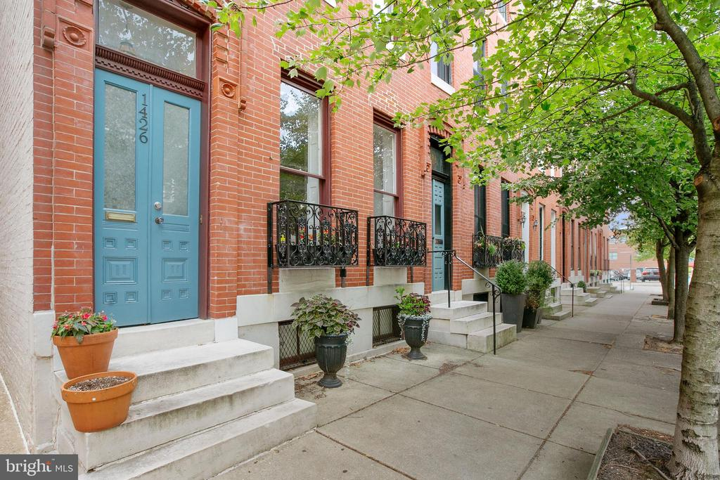 Open House Sunday 7/25 from 12:30-2:00. Modern, warm and welcoming, this fully renovated Bolton Hill townhome offers an unexpected blend of contemporary design and  historic details. Gleaming original variable-width hardwood floors provide character and charm to this modern reimagination of an 1880's historic abode. The open riser, contemporary staircase creates a sculptural architectural design feature that catches the eye while also allowing for the free movement of light throughout the home. In addition to the generously proportioned skylight over the floating stairs, this bright and sunny end-of-group townhouse has oversized windows on three sides. The exposed brick provides a richness and texture along with a true connection to the home's historic past. The layout of this four bedroom home offers a formal living room, separate dining room, eat in kitchen and half bath on the first floor. The second floor includes two bedrooms, a full bath and large family room/den. The third floor is currently used as a primary bedroom suite which includes a large bedroom, a full bath with laundry, and a nicely proportioned separate office/dressing room/nursery. In addition to the abundant closet space on all three upper levels, the unfinished basement provides extra storage capacity and ample room for a workbench or craft area. The home's eat-in-kitchen leads seamlessly to the fully fenced and professionally landscaped courtyard garden.  Perfect for a commuter or weekend traveler, this  home is conveniently located in the south eastern section of Bolton Hill for easy access to Penn Station for Amtrak, MARC, JHU shuttle, and close to  the Bolt Bus, Light Rail service to BWI as well as the Baltimore Metro.