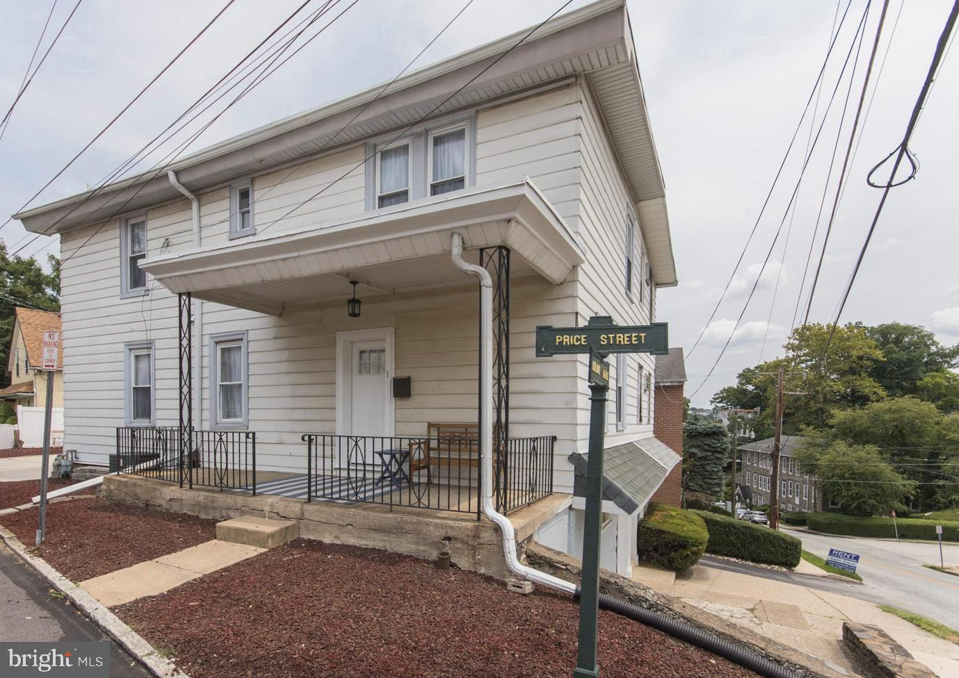 1 Price Street has it all! This 2 bedroom, 1 bathroom twin is located in Lower Merion's award winning school district and is walkable to shops and restaurants in Manayunk, a local park and an outdoor swim facility. This property underwent a full interior upgrade in 2017. The first floor is an open concept living area comprised of a modern kitchen and a spacious dining room and living room. Downstairs, you will find a walk out finished basement with an exterior patio and ample space for a play room, office or exercise area. The second floor includes two large bedrooms, a recently updated bathroom and main floor laundry. This property has a driveway large enough for two full sized cars and three outdoor seating areas.