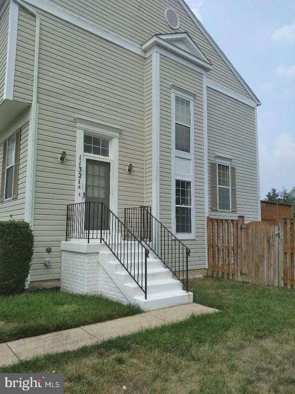 This Townhouse shows with furniture, but it is vacant.  It is a large townhouse with 4 bedrooms with full baths on each floor with tubs.  Fenced 8 foot back yard with deck off  kitchen.  Beautiful shed in back yard.  Freshly painted  walls & steamed carpet.  Fence to be painted in front this weekend.