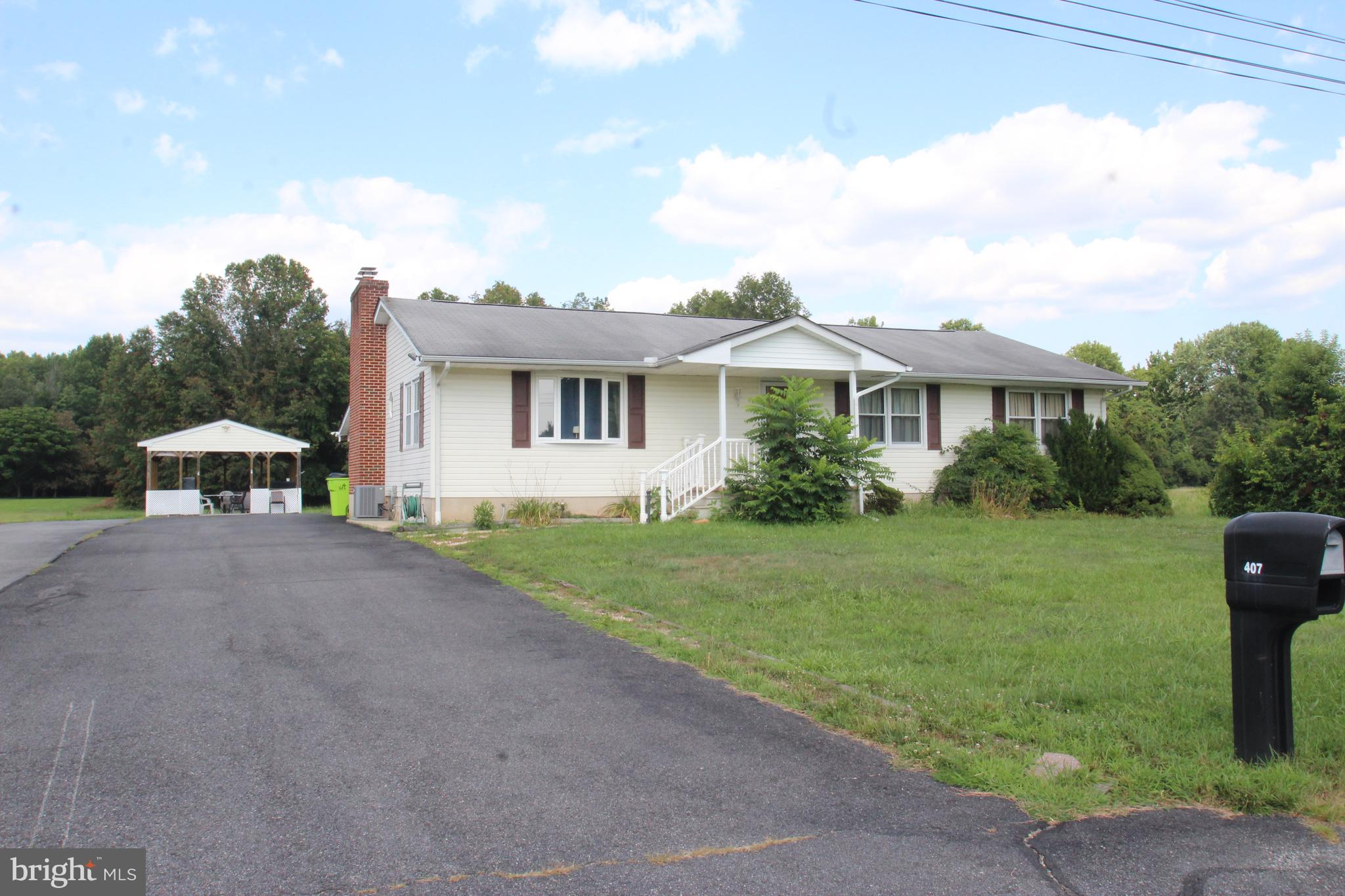 Rare find in AppoquiniminkSchool district! 3BR, 3BA Ranch home on 1 acre lot with enclosed rear porch. Large living room leads to Family room with brick fireplace. Eat in kitchen overlooks the rear yard. The basement is semi finished with a den, 2nd family room and full bath. This home is a little dated, but has good bones.